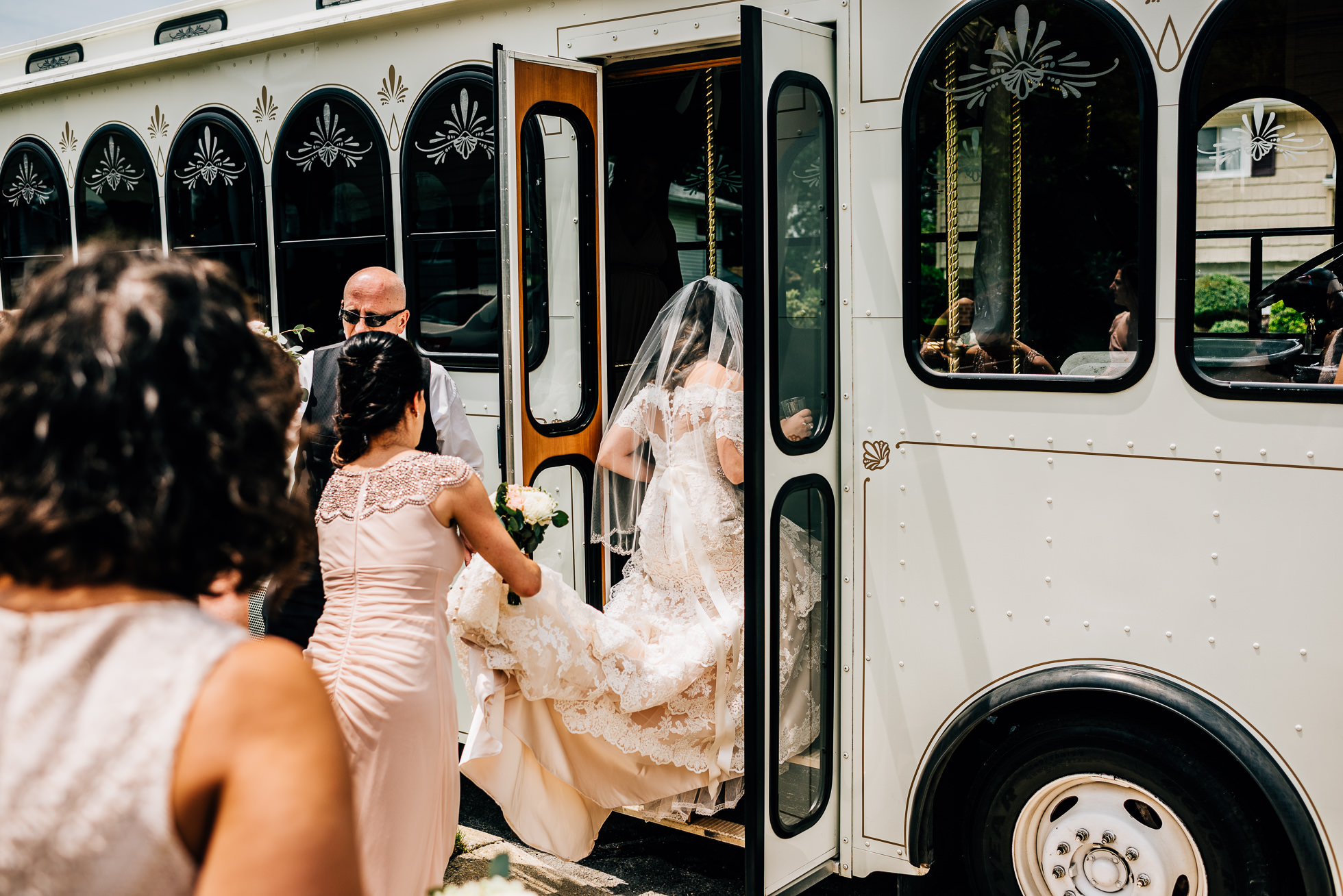 bride getting in trolley long island