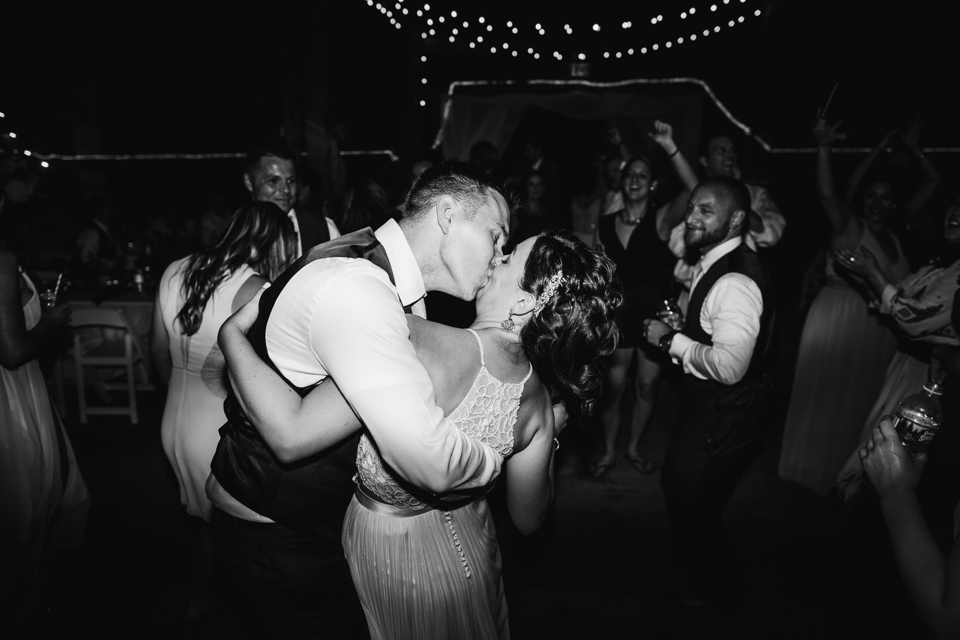 bride groom reception kiss