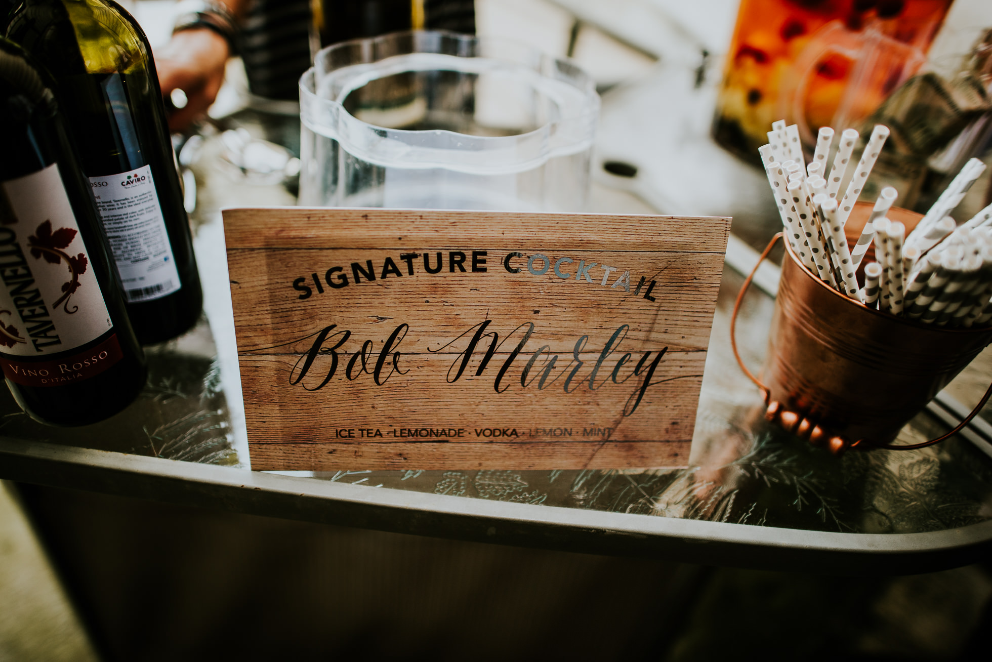 signature cocktail at olde tater barn wedding photographed by traverse the tides