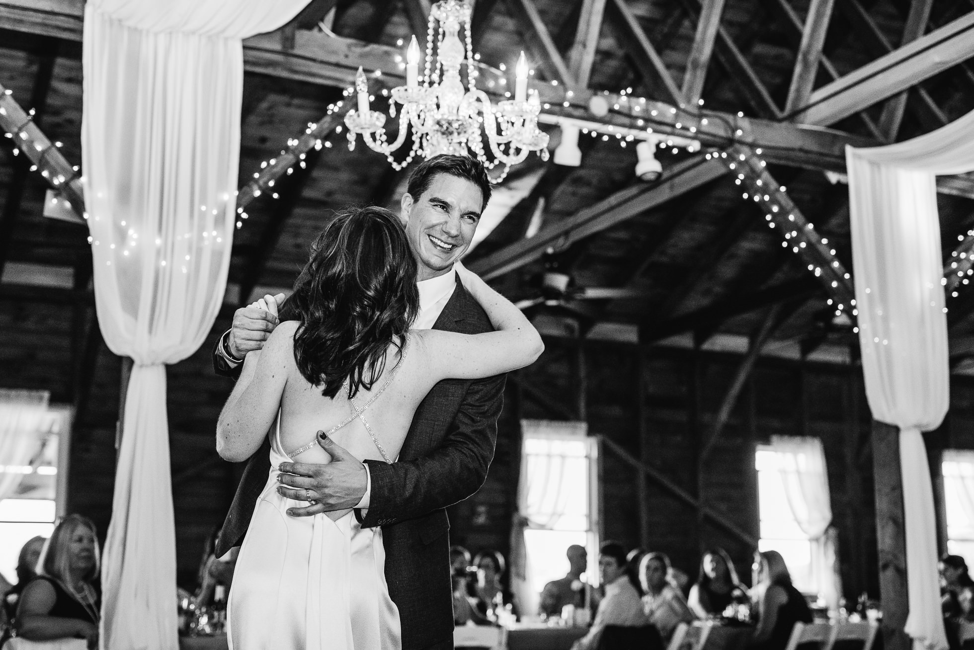 first dance at reception at olde tater barn wedding in central bridge, ny photographed by traverse the tides