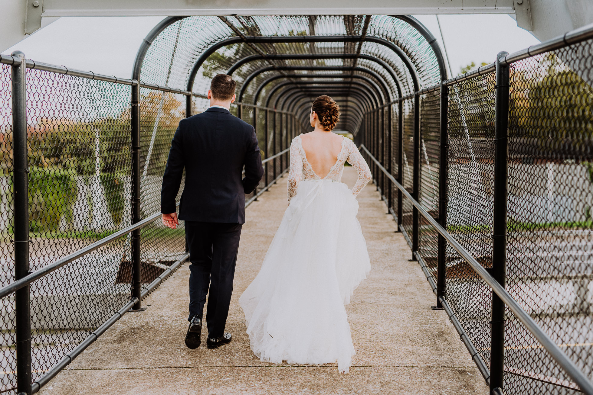 bride and groom walking on overpass in nashville tennessee