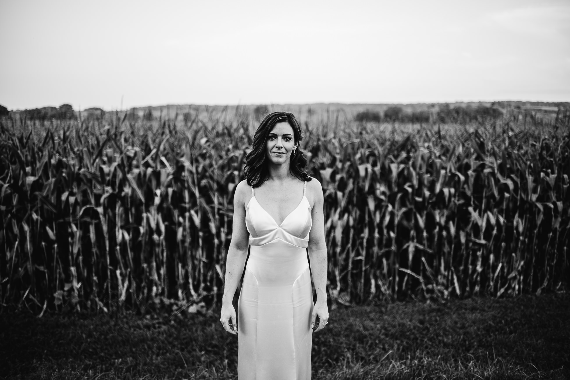 bride portrait near corn field at olde tater barn wedding in central bridge, ny photographed by traverse the tides