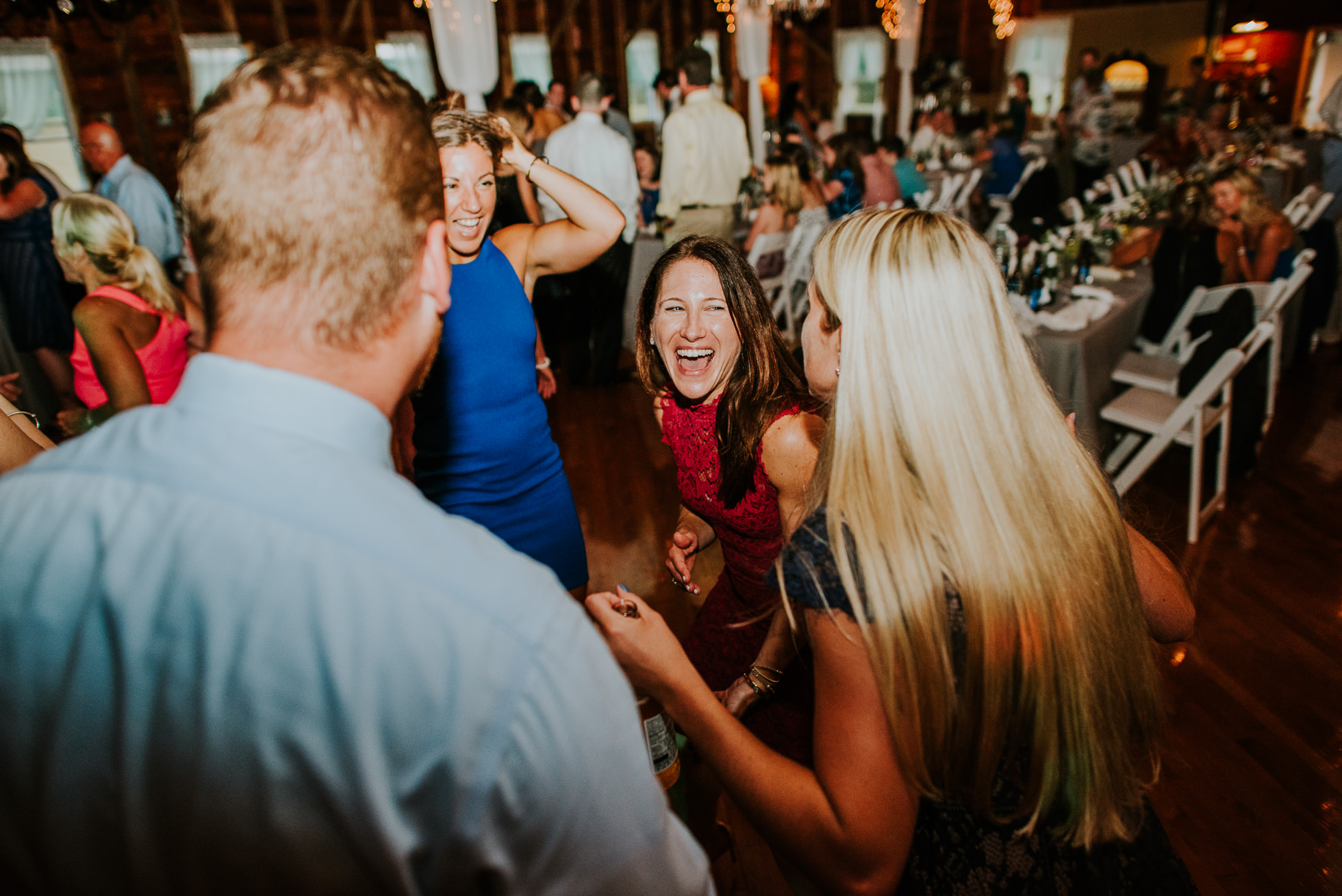guests partying at olde tater barn wedding in central bridge, ny photographed by traverse the tides