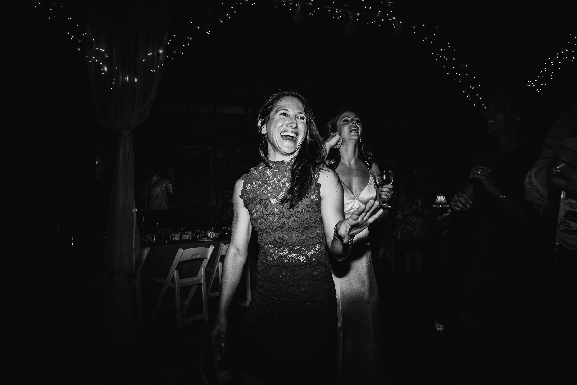 guests dancing at olde tater barn wedding in central bridge, ny photographed by traverse the tides