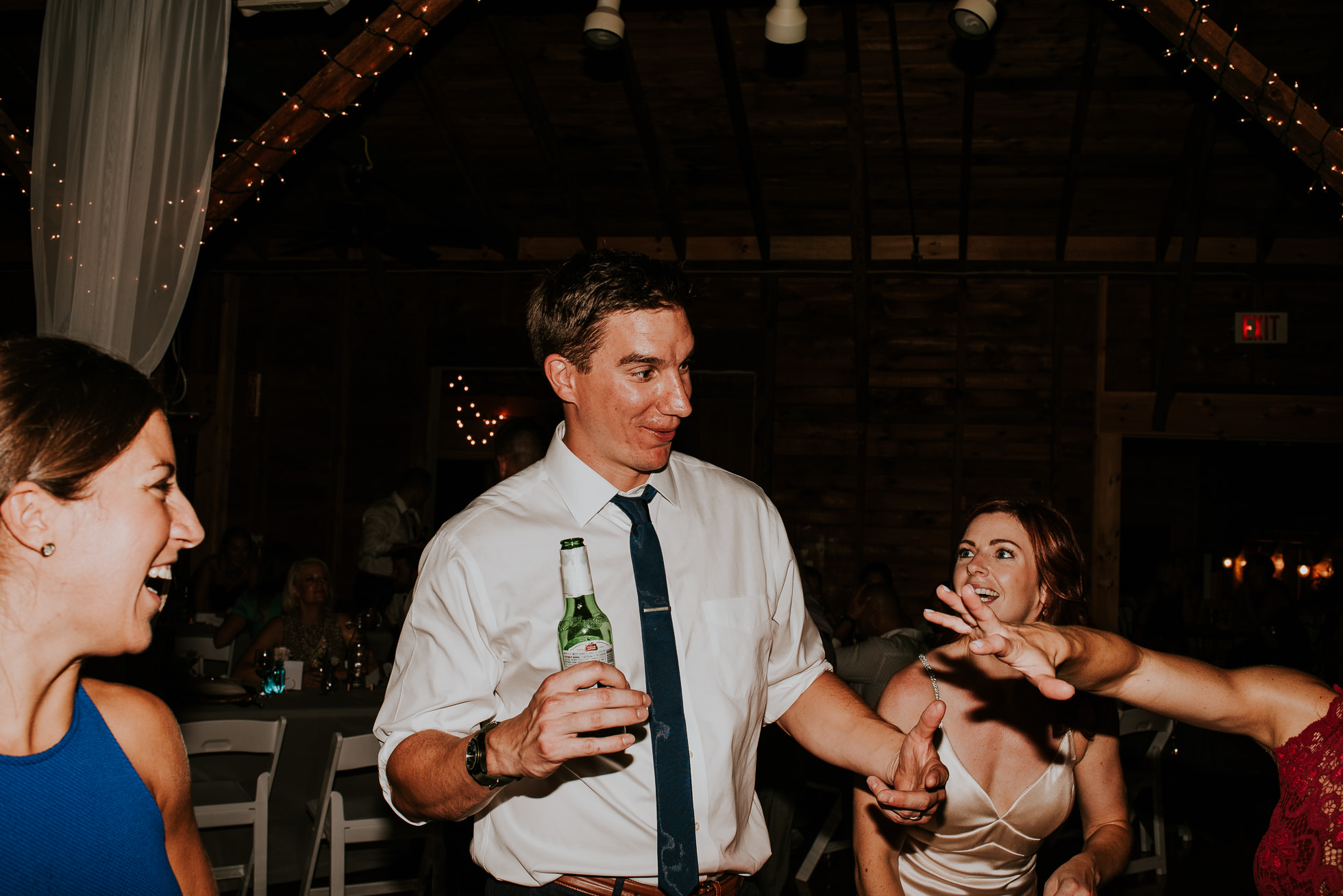 groom dancing at olde tater barn wedding in central bridge, ny photographed by traverse the tides