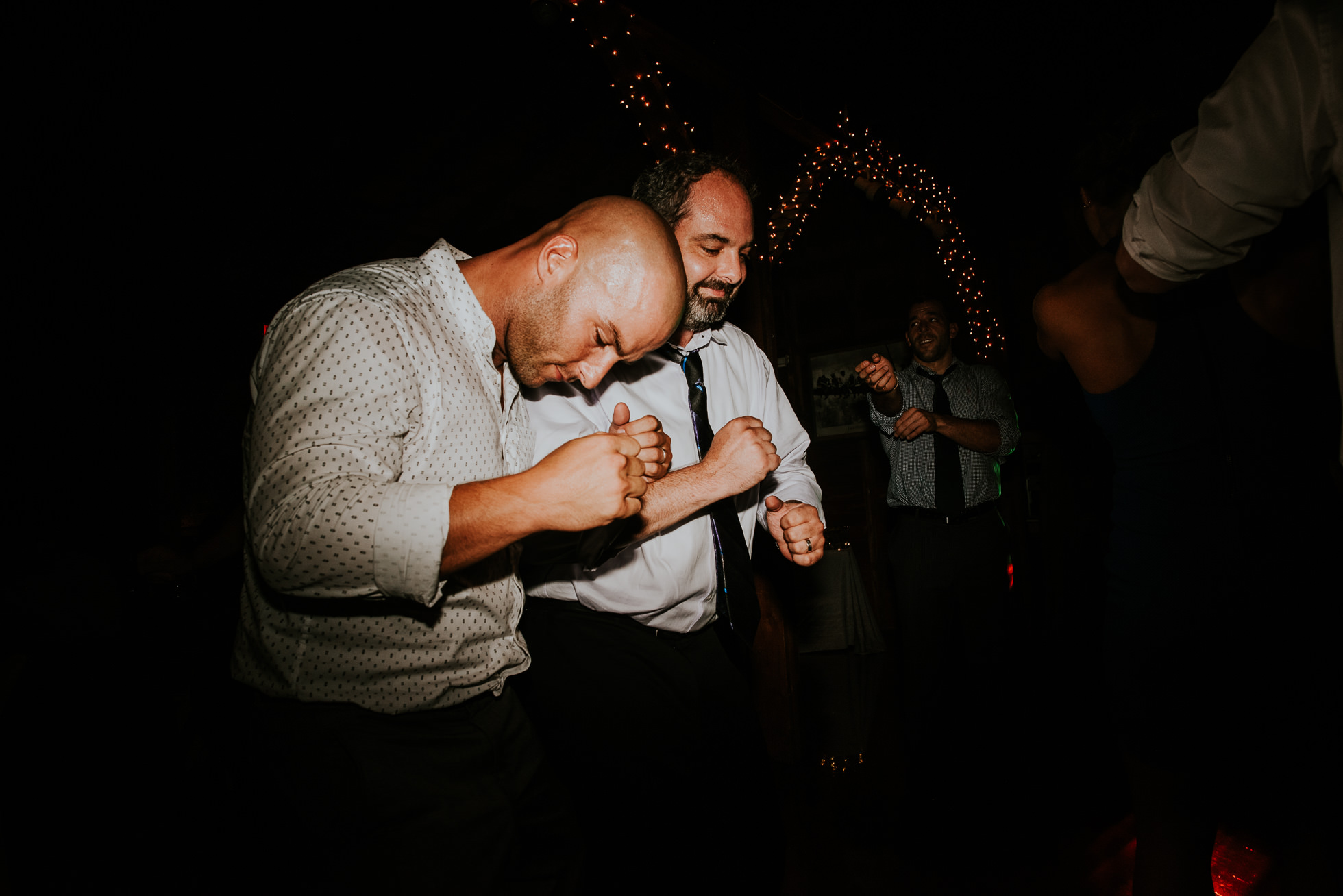 guys dancing at olde tater barn wedding in central bridge, ny photographed by traverse the tides