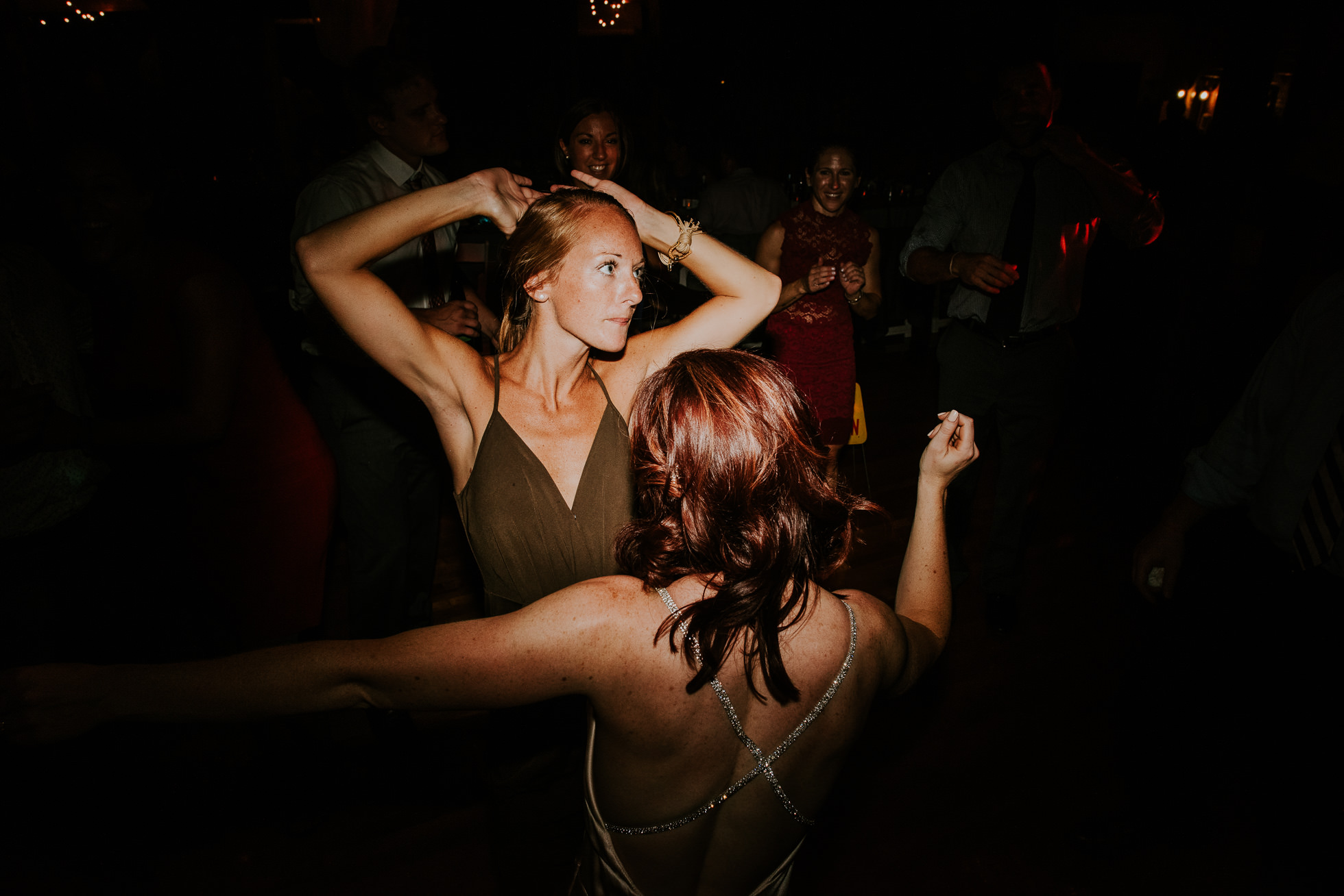 girls dancing at olde tater barn wedding in central bridge, ny photographed by traverse the tides