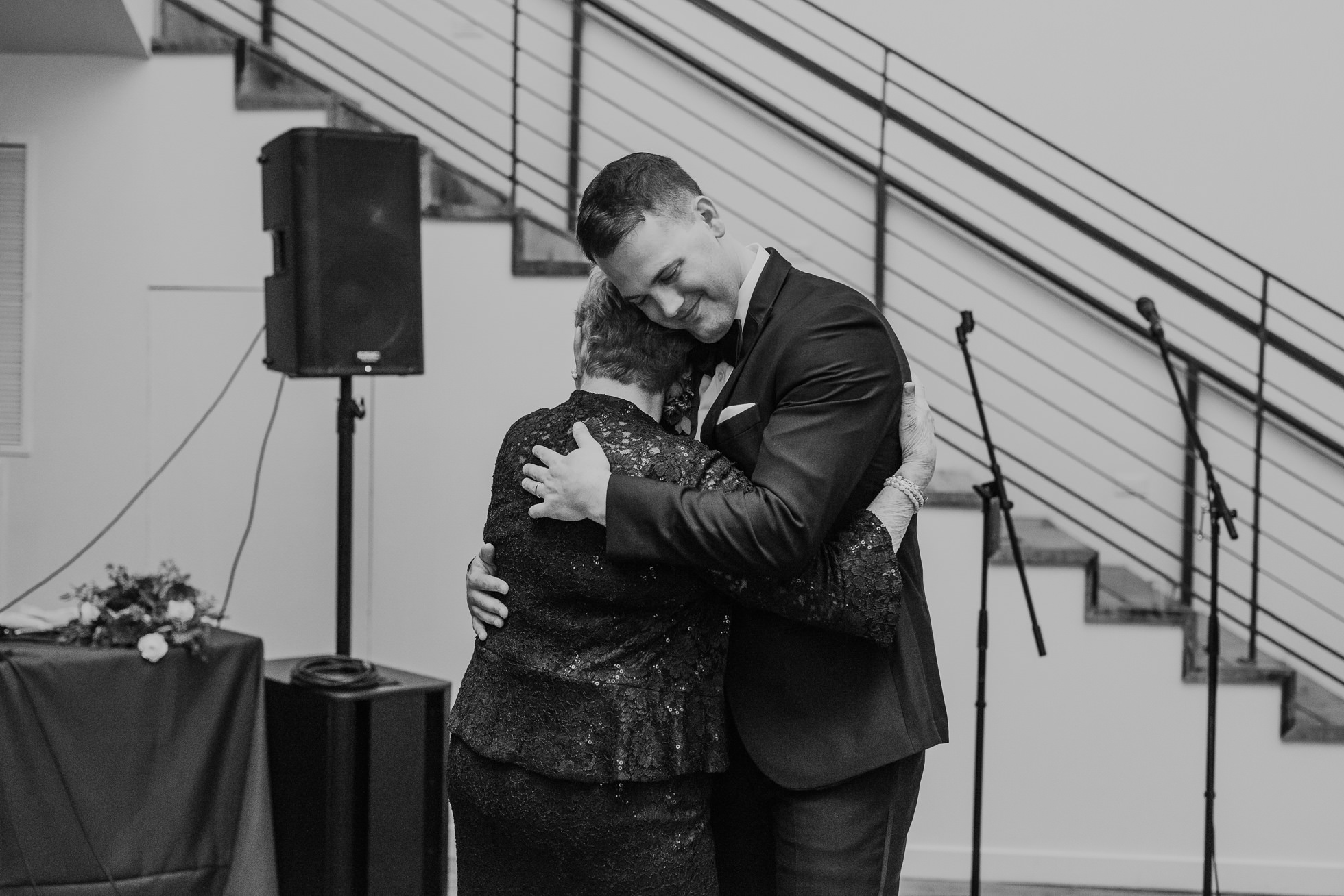 groom and grandmother hug at the cordelle wedding reception