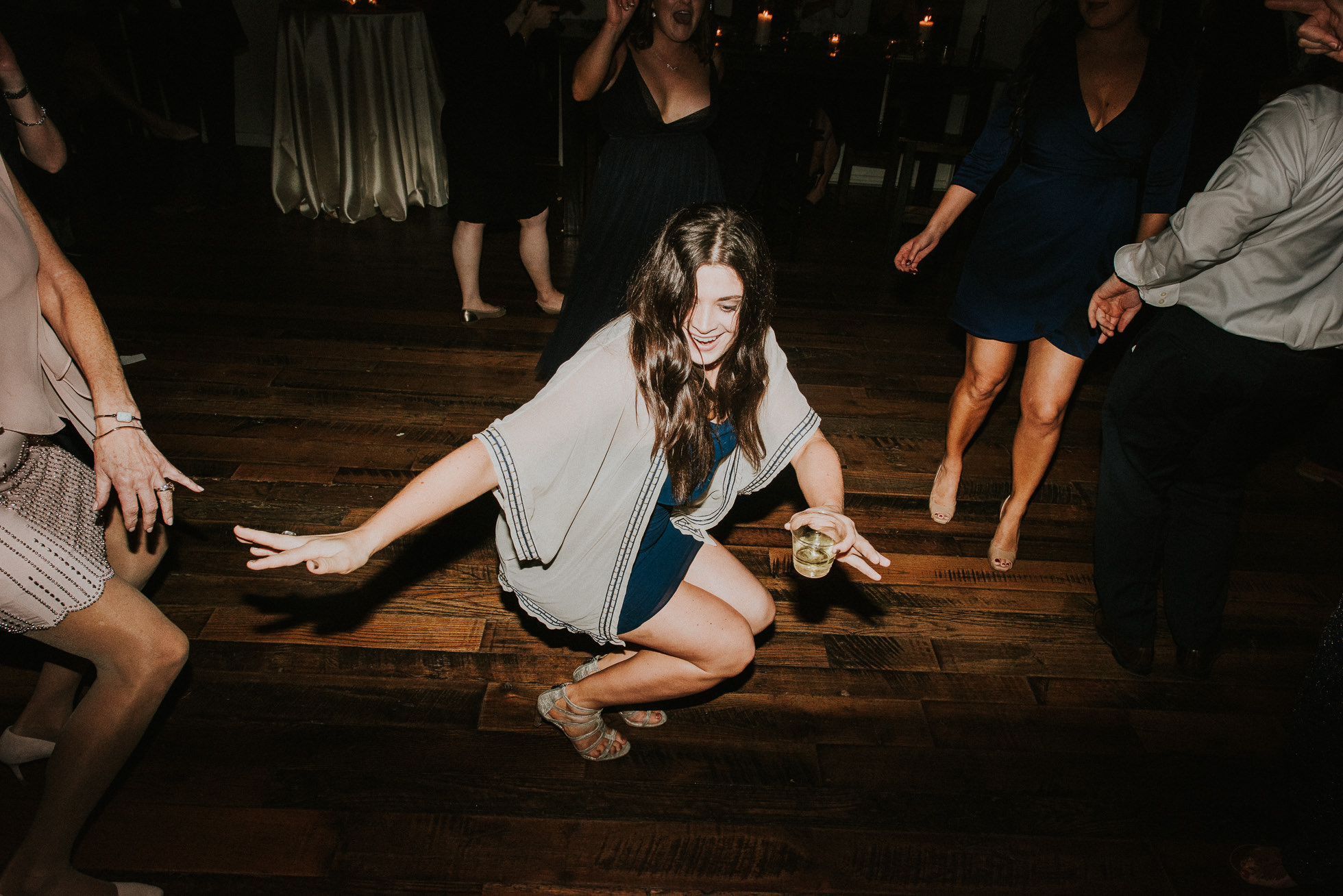 girl dancing low at reception the cordelle