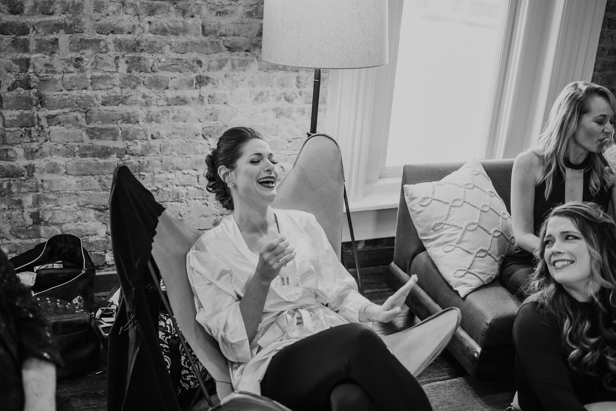 bride laughing at getting ready