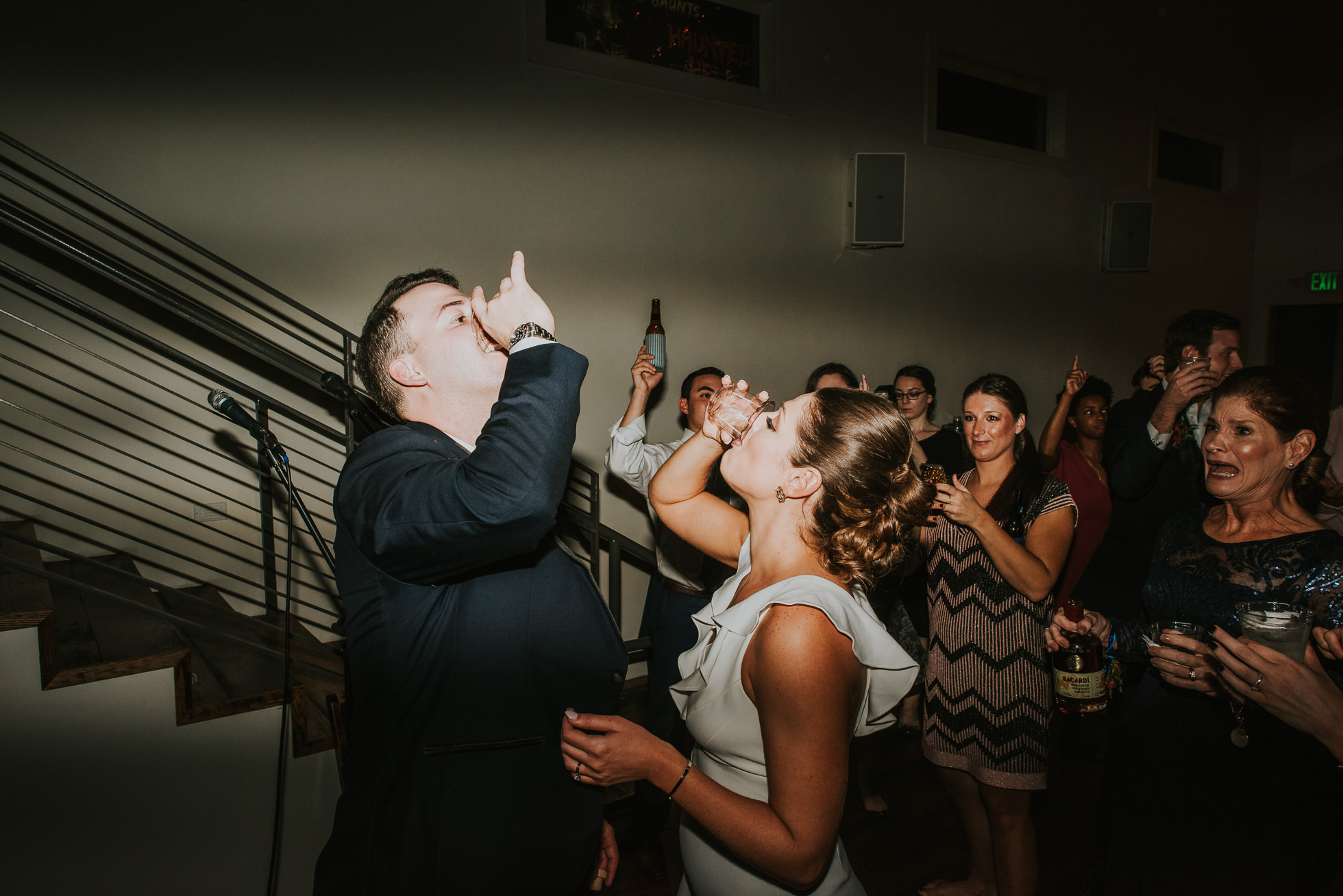 bride and groom drinking shots at wedding reception at the cordelle nashville wedding