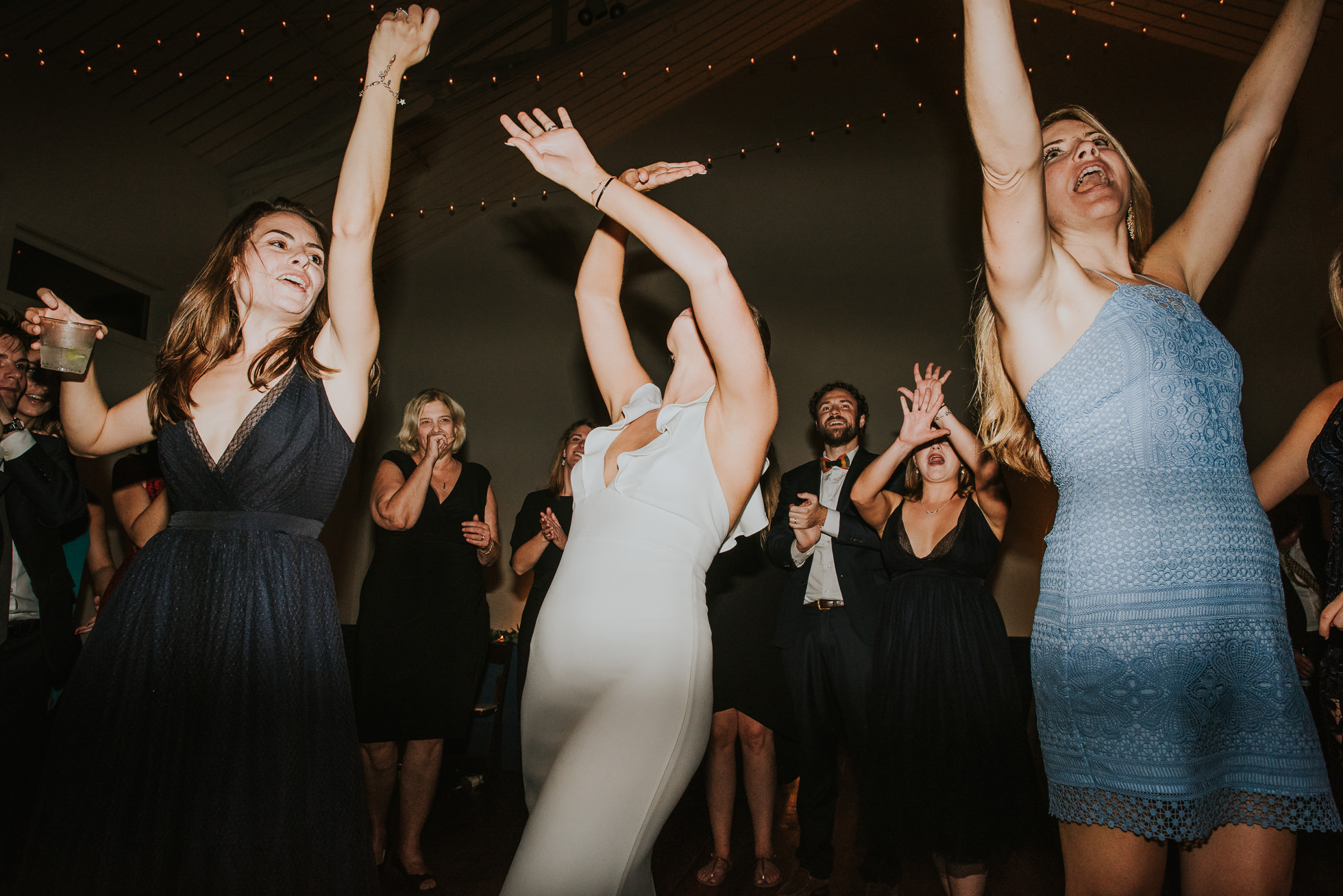 bride and friends dancing at wedding reception at the cordelle nashville wedding