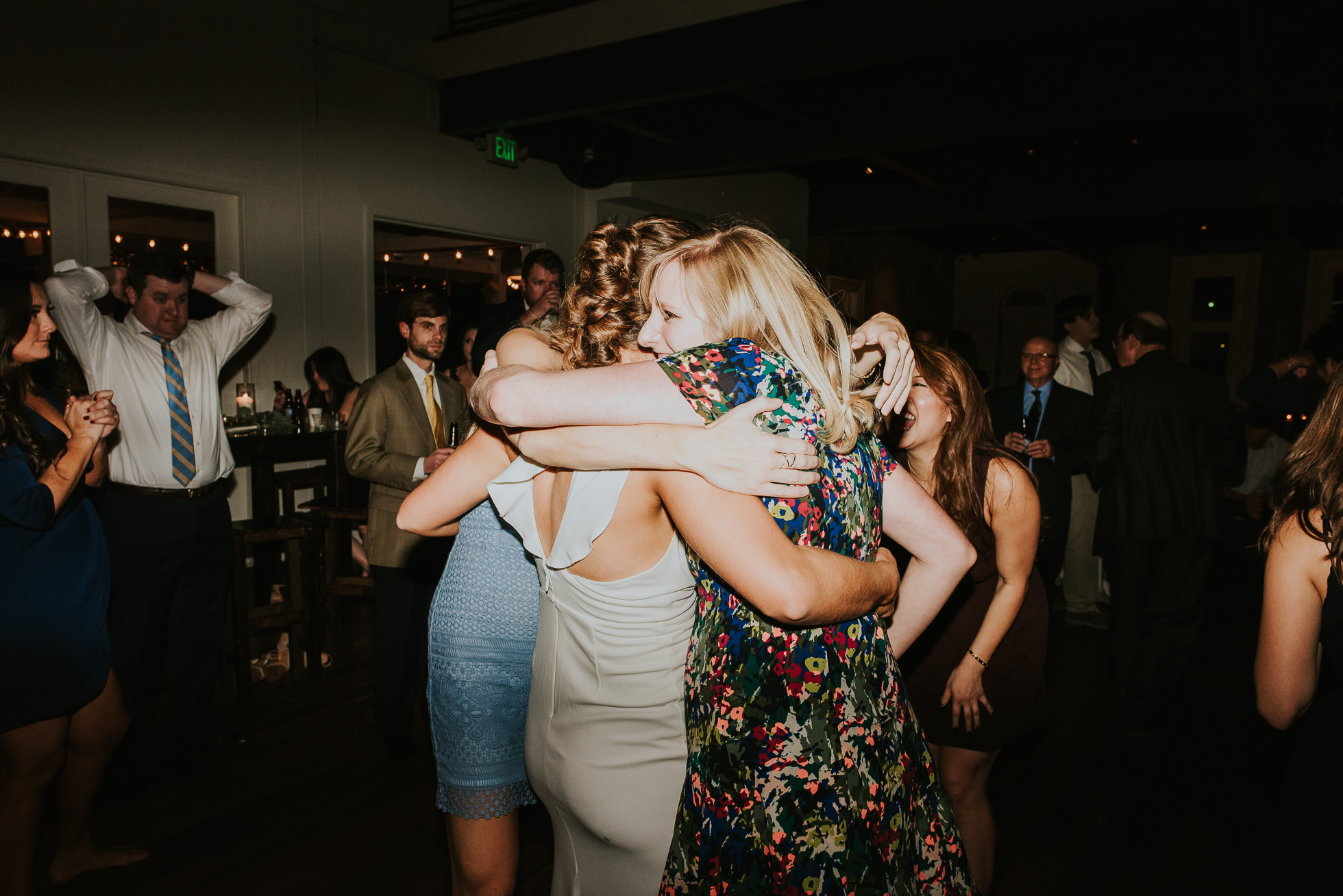 bride and friends hugging at wedding reception at the cordelle nashville wedding