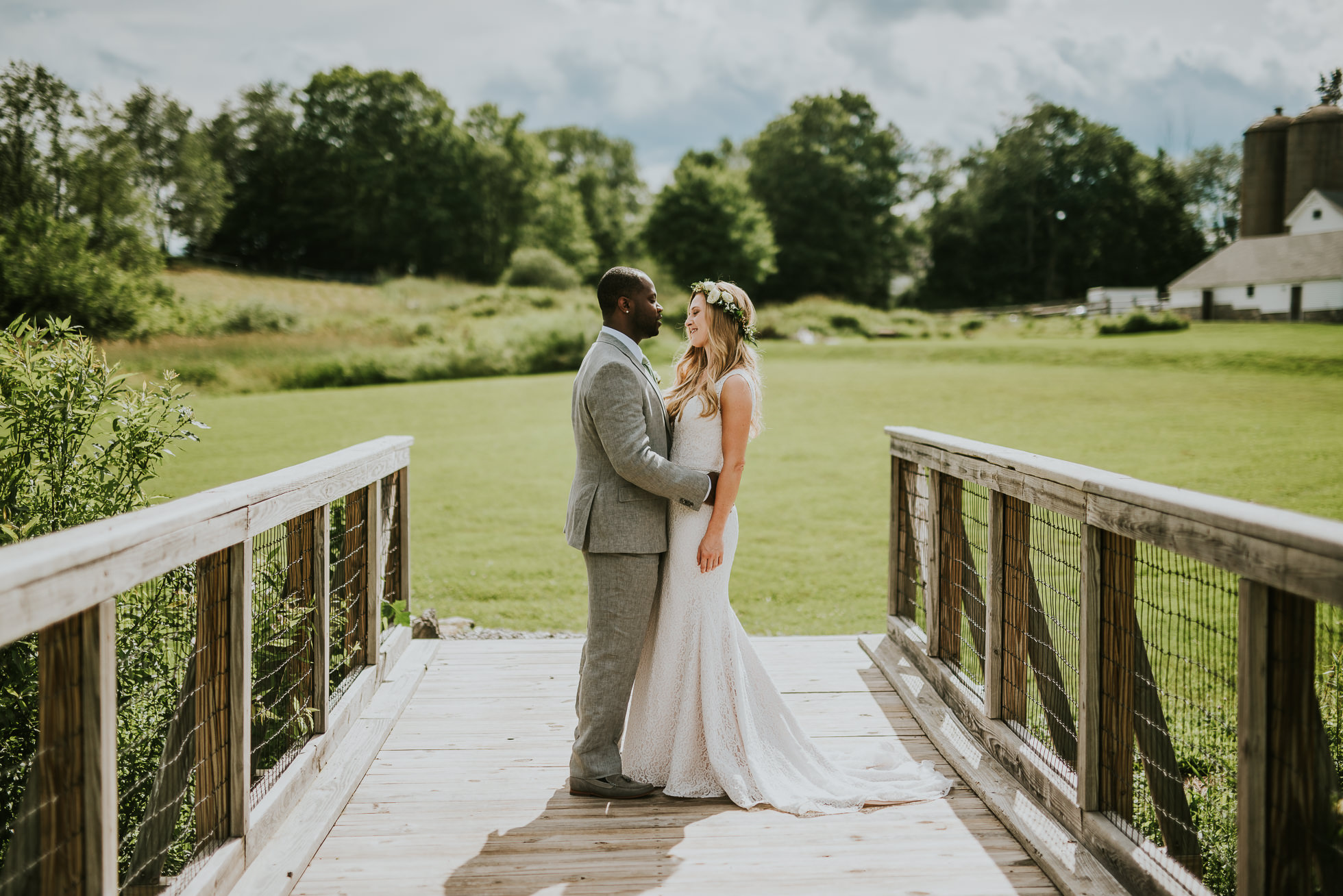 bride and groom on a bridge photographed by Traverse the Tides