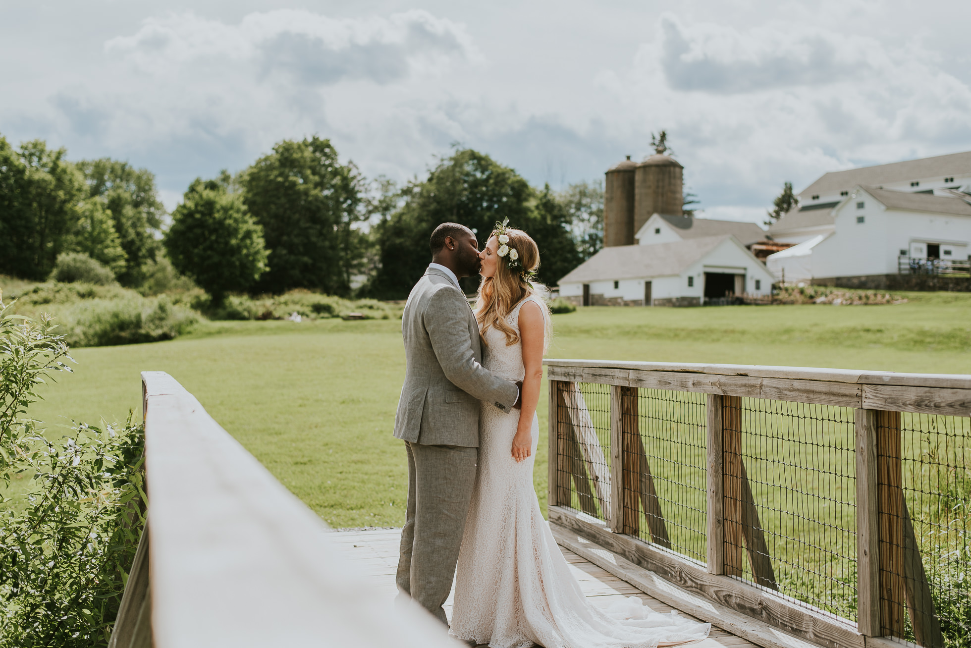 rustic wedding first kiss photographed by Traverse the Tides