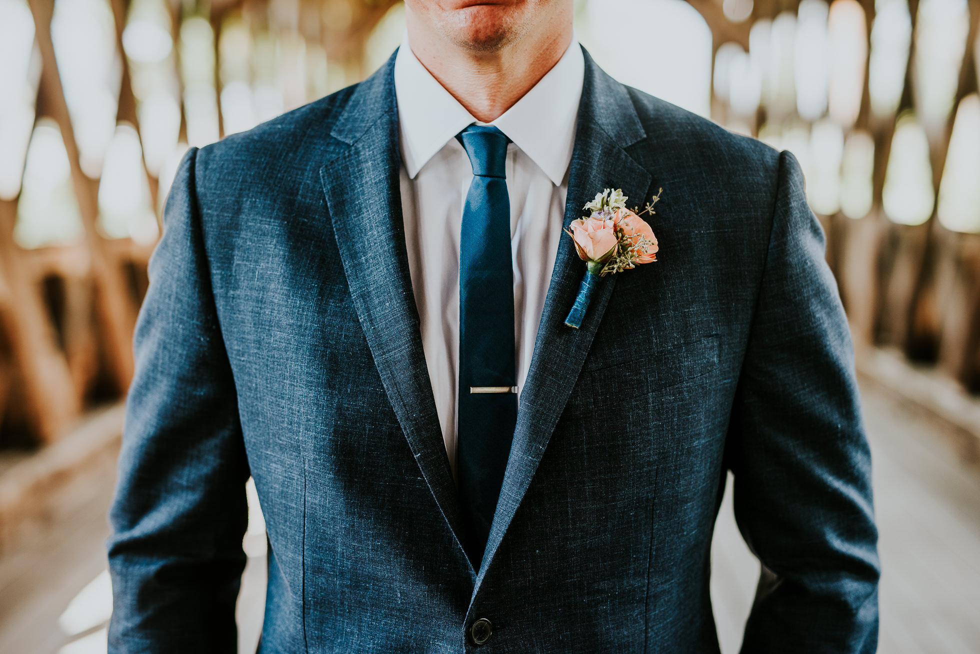 groom's suit at olde tater barn wedding in central bridge, ny photographed by traverse the tides