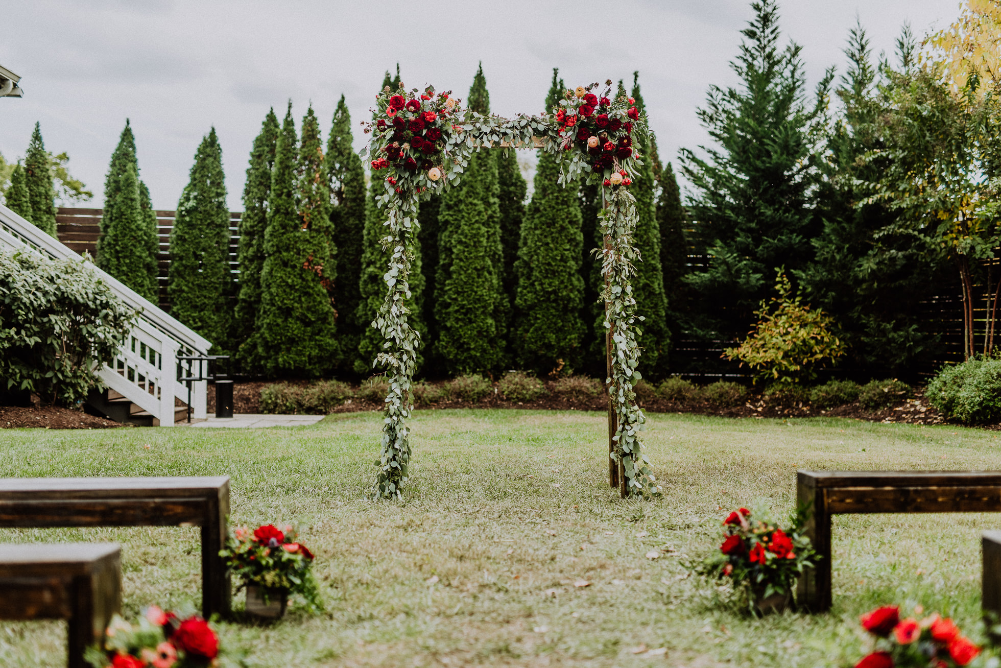 red floral wedding arch nashville
