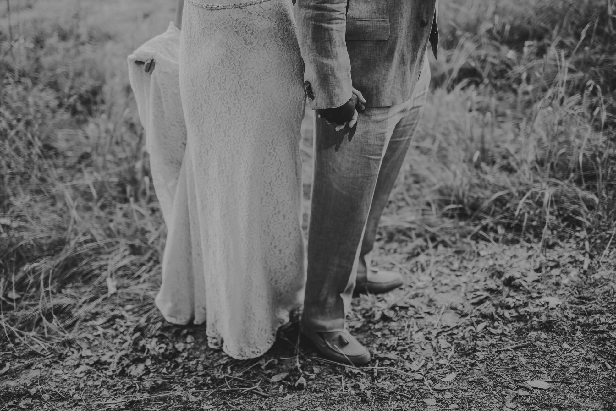 bride and groom holding hands photographed by Traverse the Tides