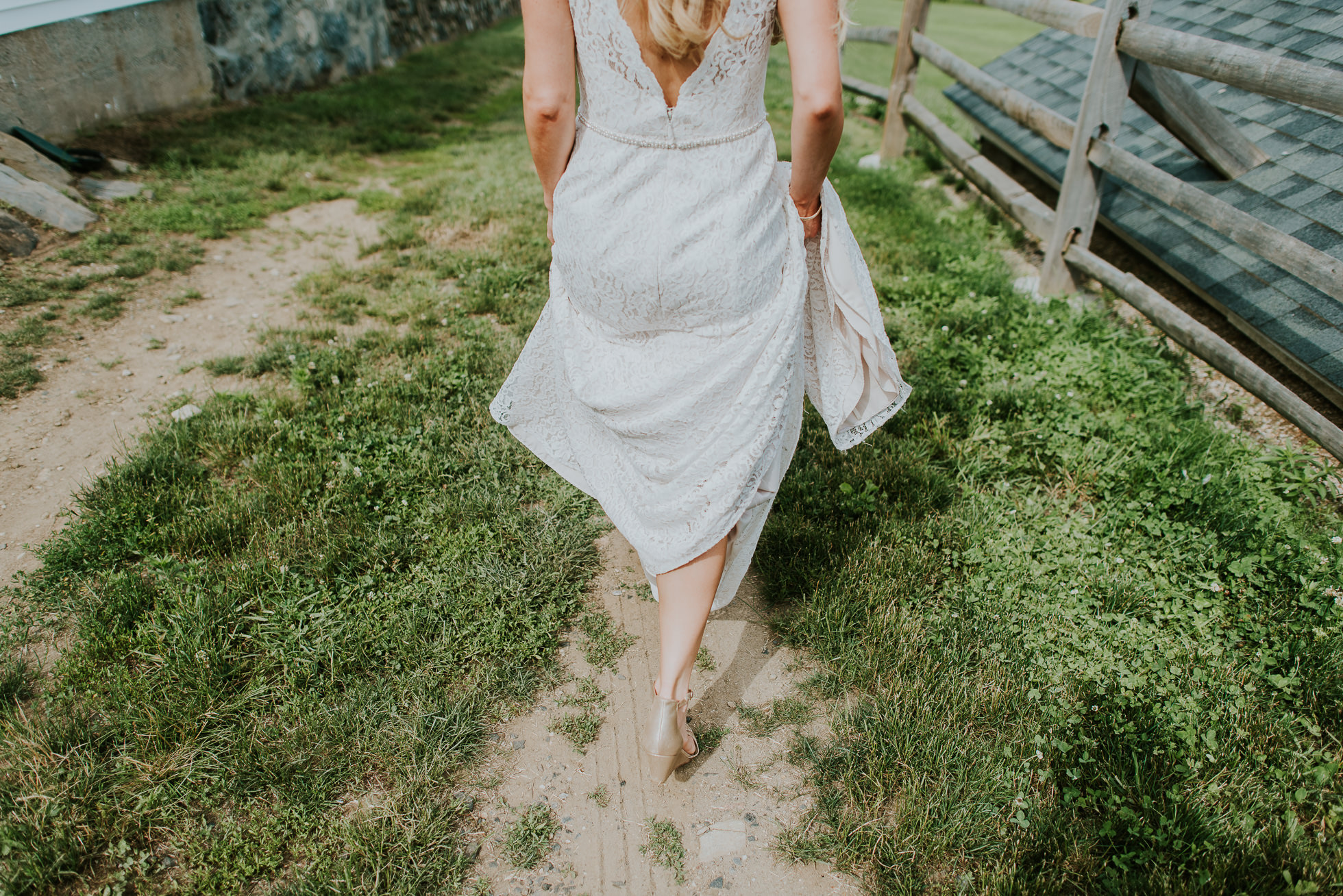 bride walking on a farm photographed by Traverse the Tides