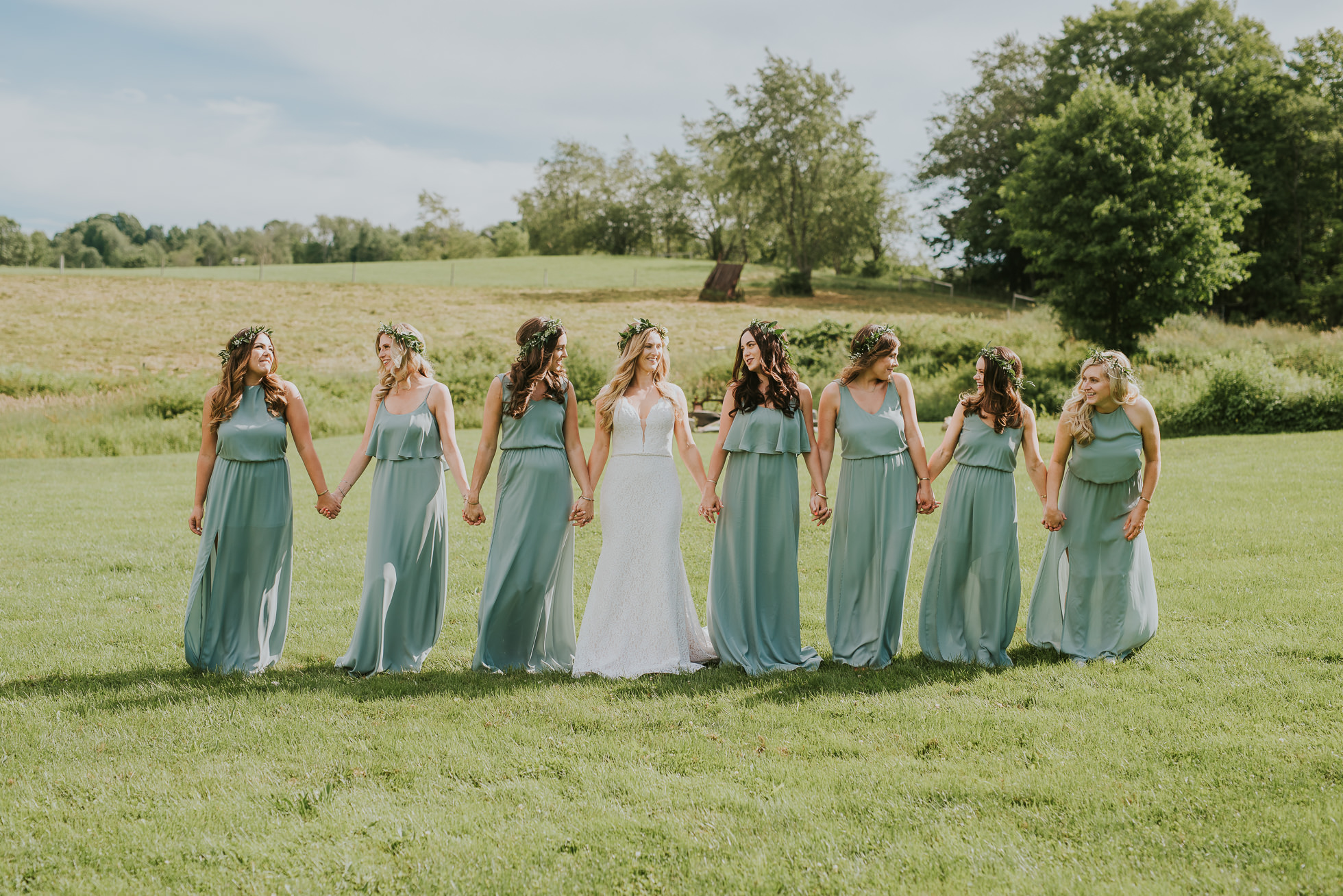 bridesmaids wearing flower crowns photographed by Traverse the Tides