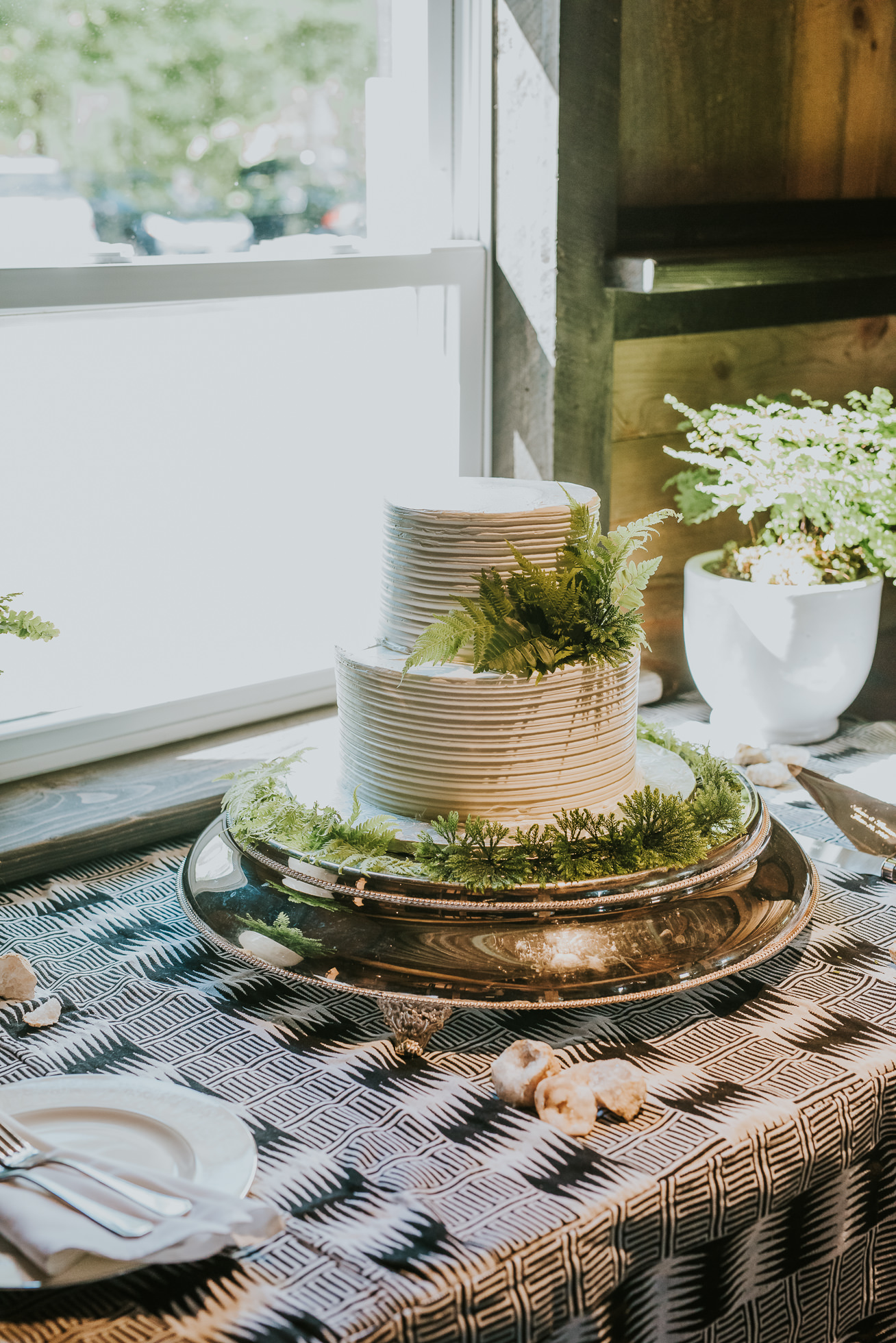 rustic wedding cake photographed by Traverse the Tides