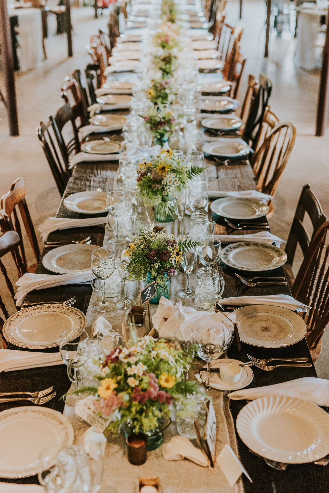 rustic vintage wedding reception table decor photographed by Traverse the Tides