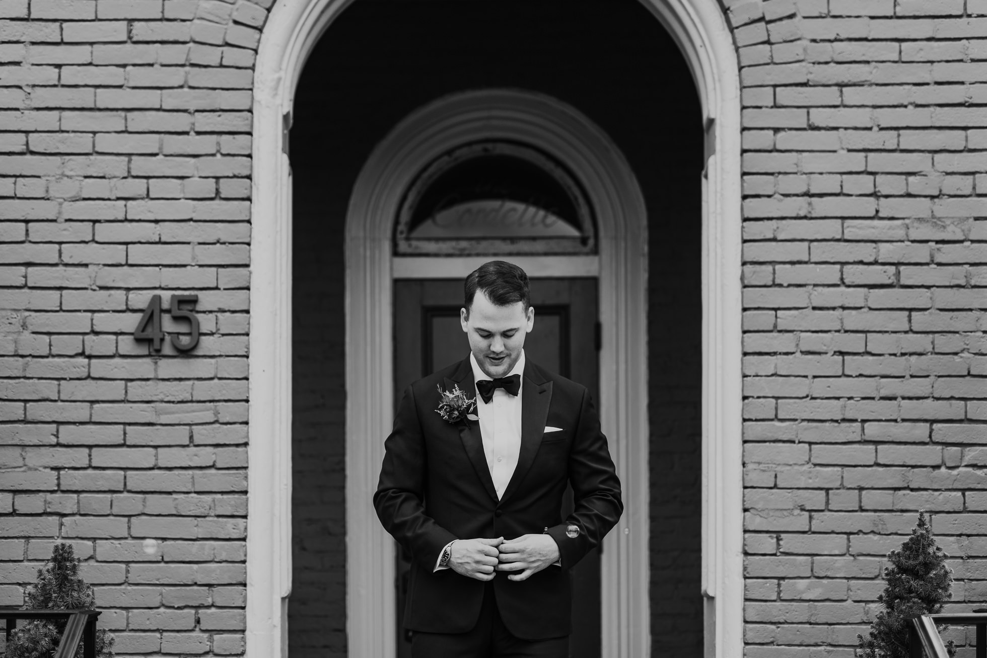 groom buttoning jacket the cordelle nashville wedding