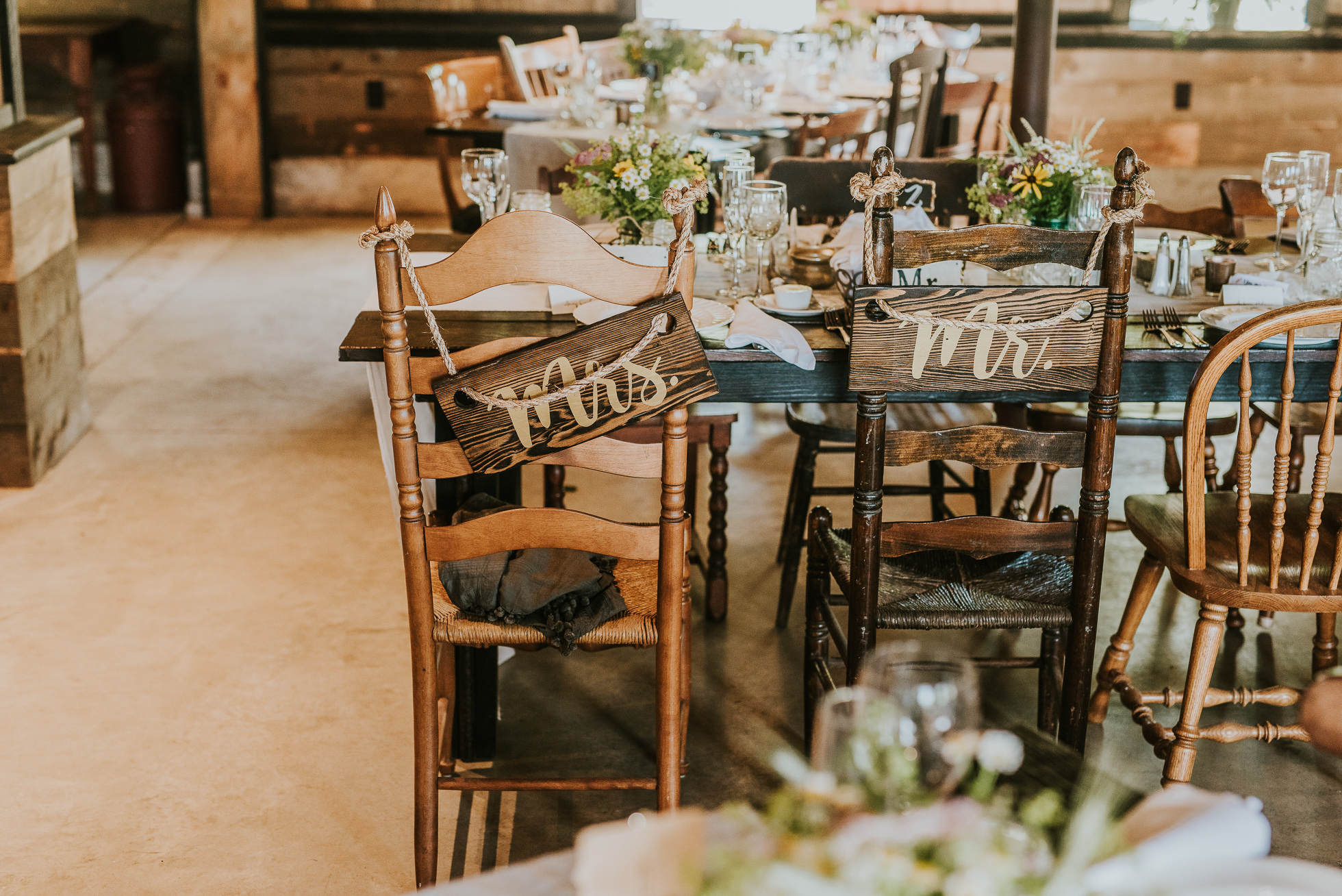 Mr & Mrs rustic wedding signs photographed by Traverse the Tides