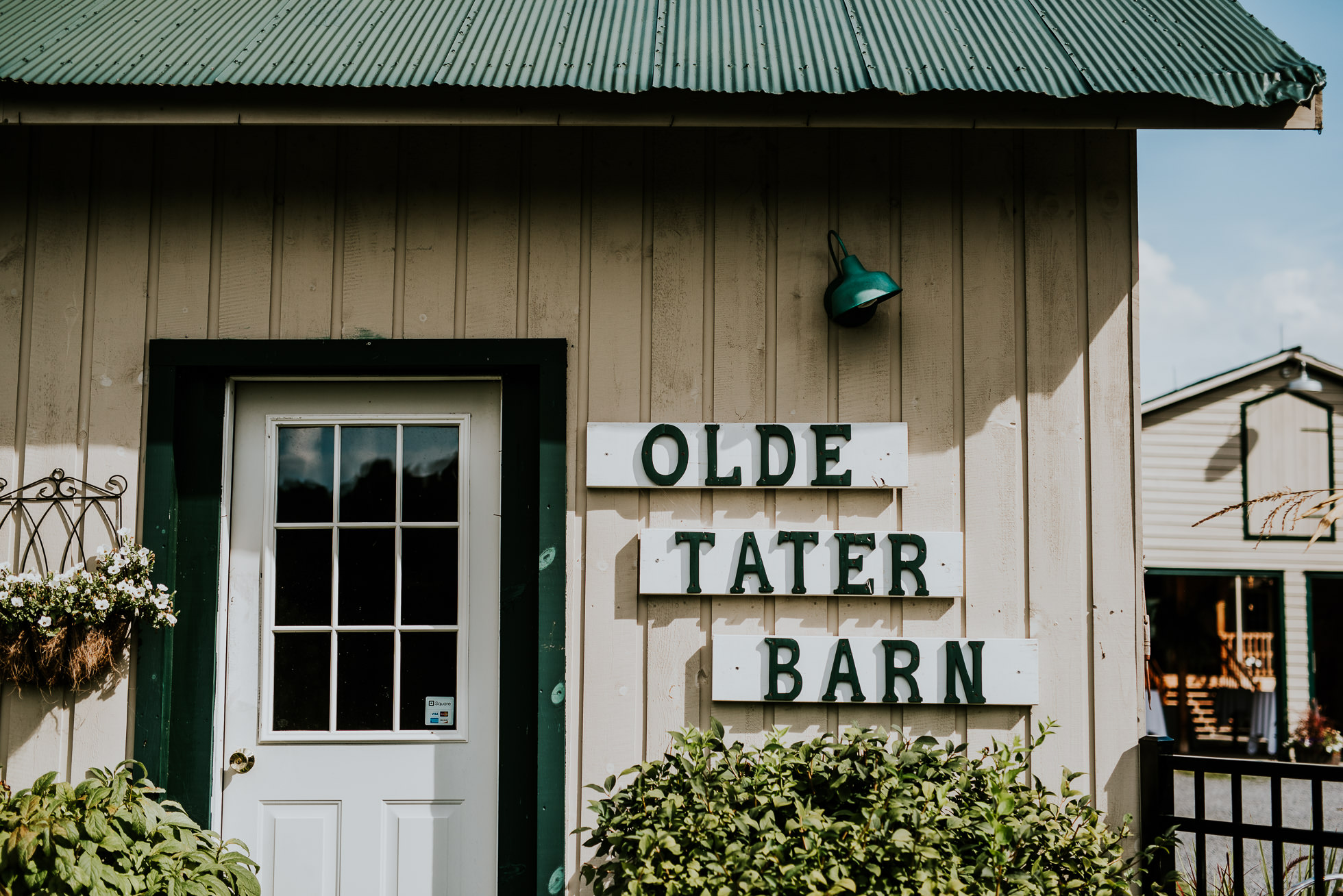 barn entrance at olde tater barn wedding in central bridge, ny photographed by traverse the tides
