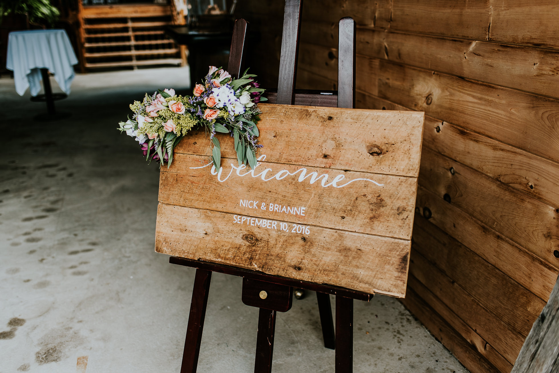 welcome sign at olde tater barn wedding photographed by traverse the tides