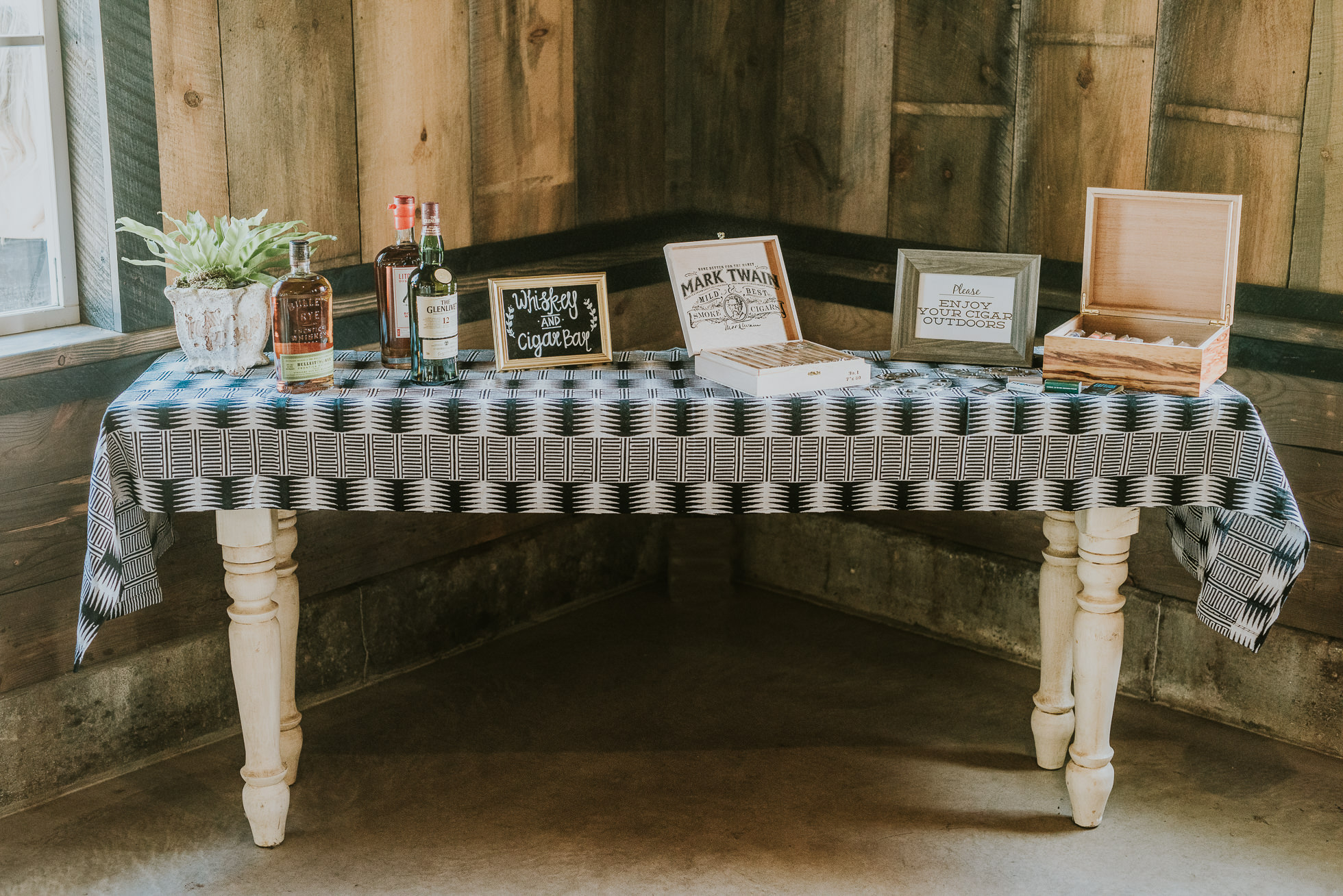 rustic cigar and whiskey table wedding photographed by Traverse the Tides