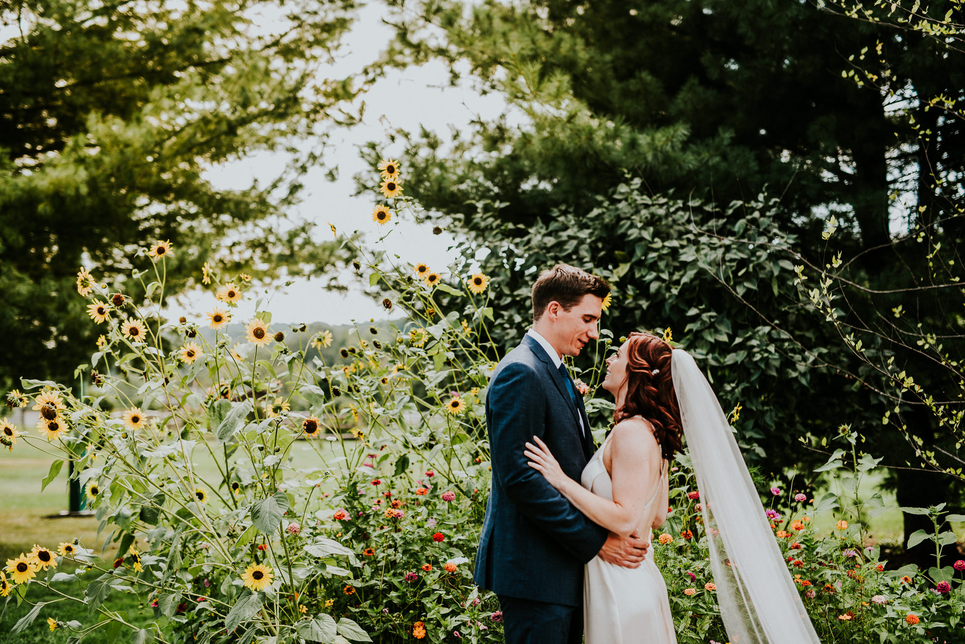 wedding portraits by flowers at olde tater barn wedding photographed by traverse the tides
