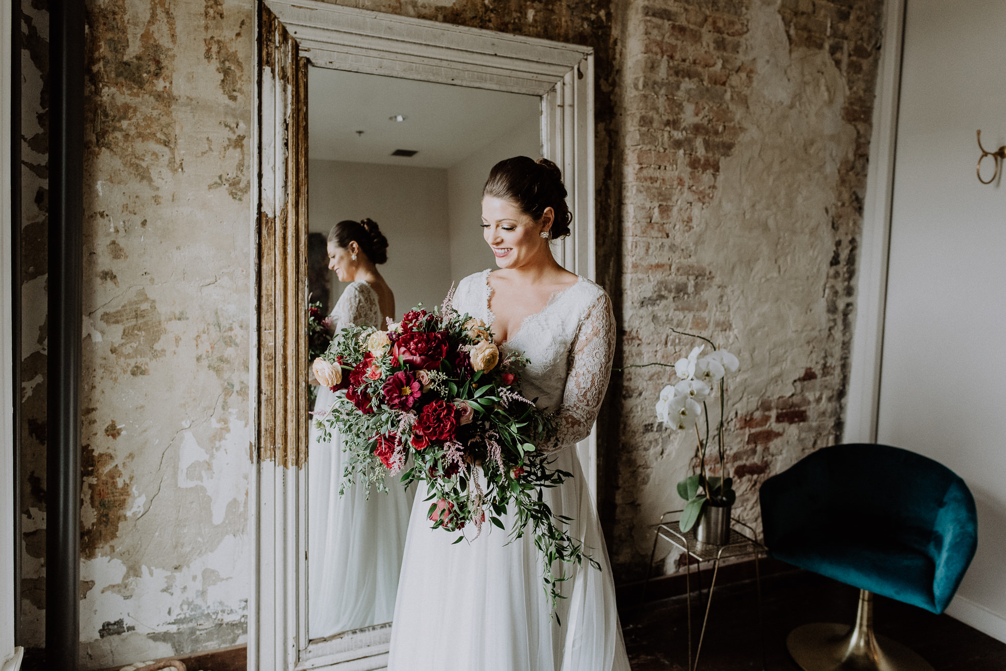 bride with red wedding bouquet the cordelle nashville wedding