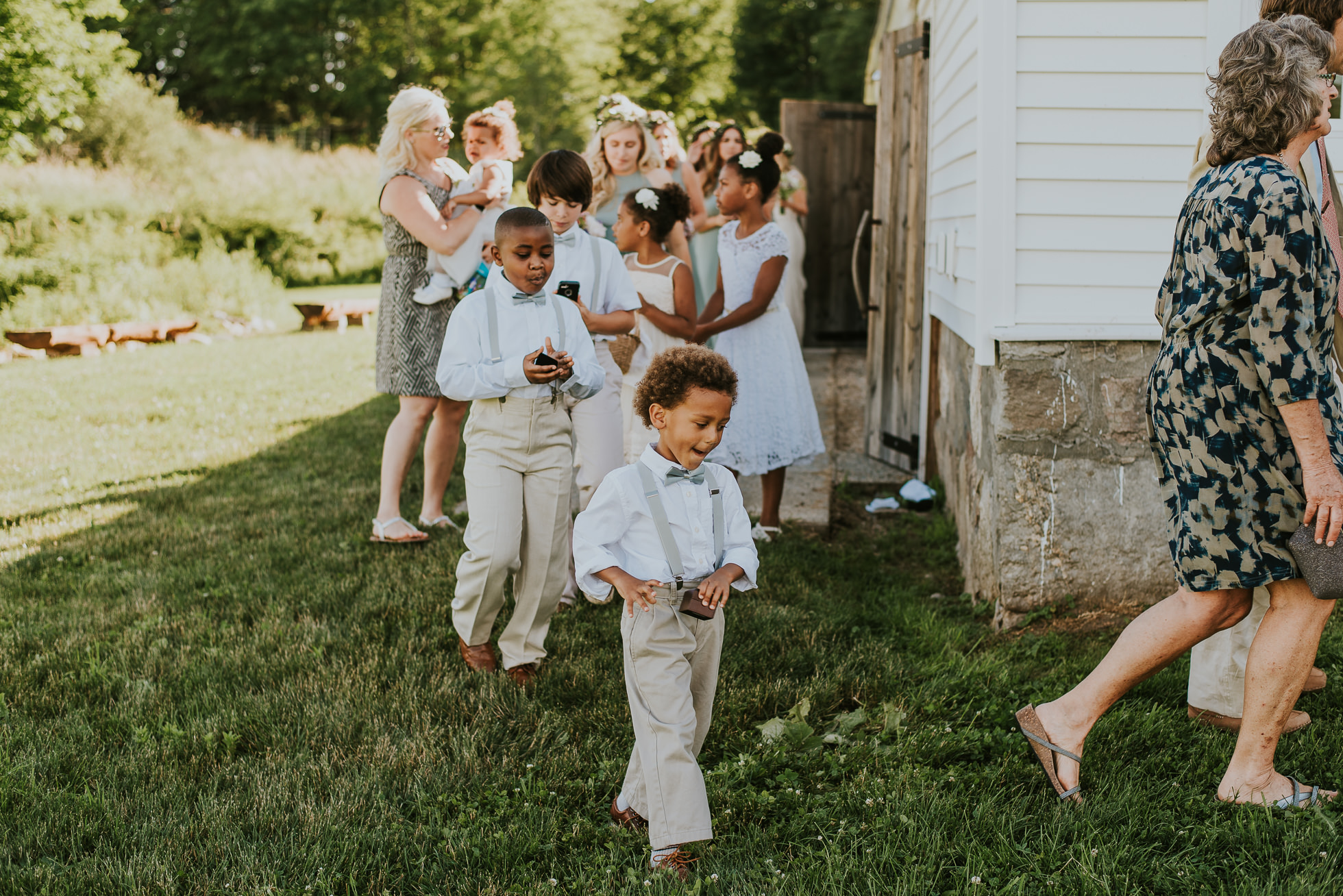 ring bearer farm wedding photographed by Traverse the Tides