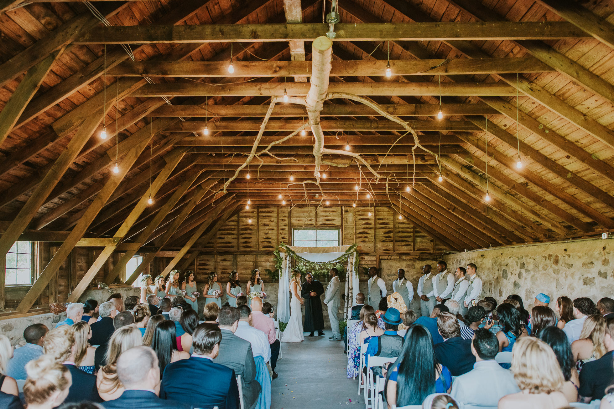 farm wedding ceremony photographed by Traverse the Tides