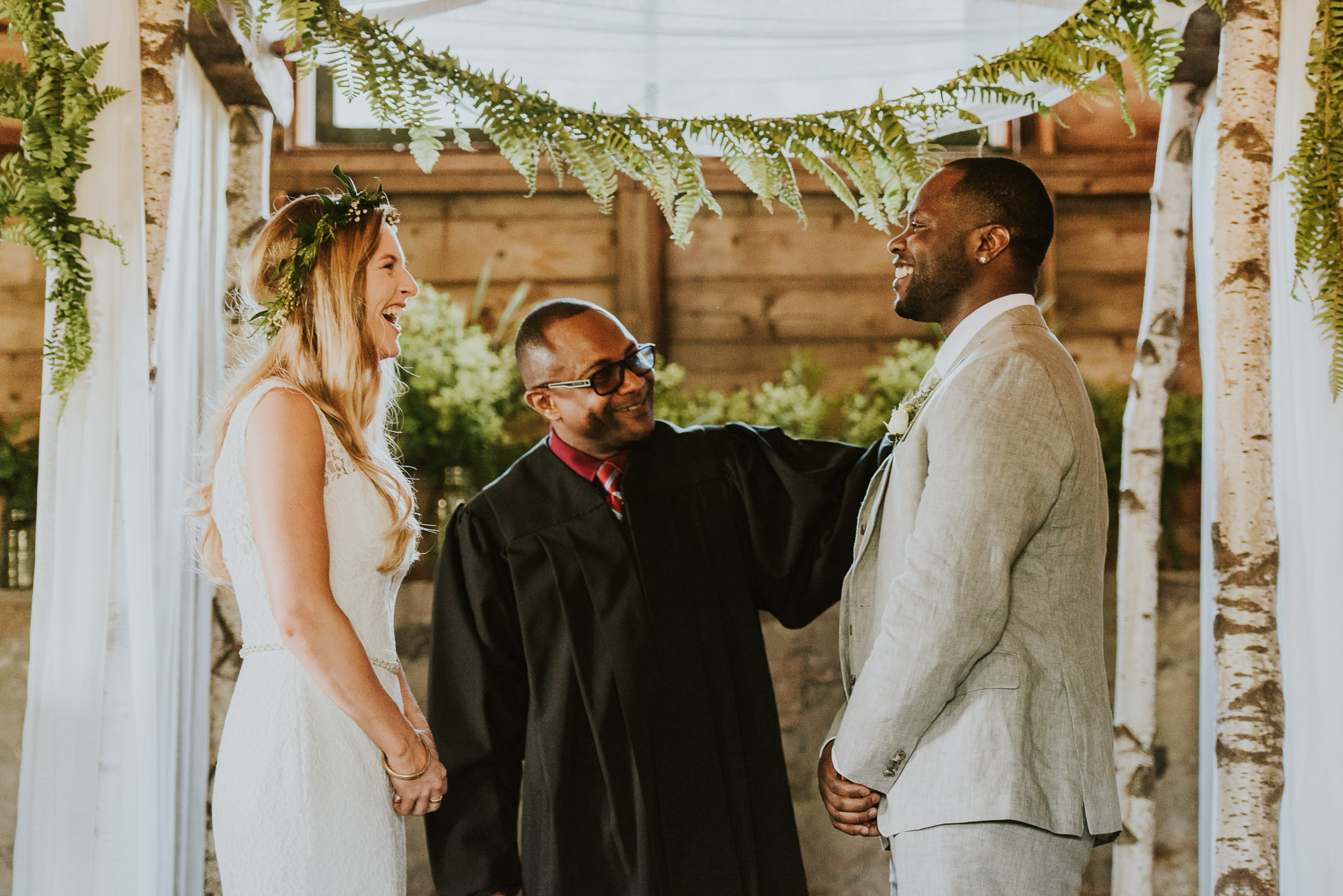rustic wedding ceremony photographed by Traverse the Tides