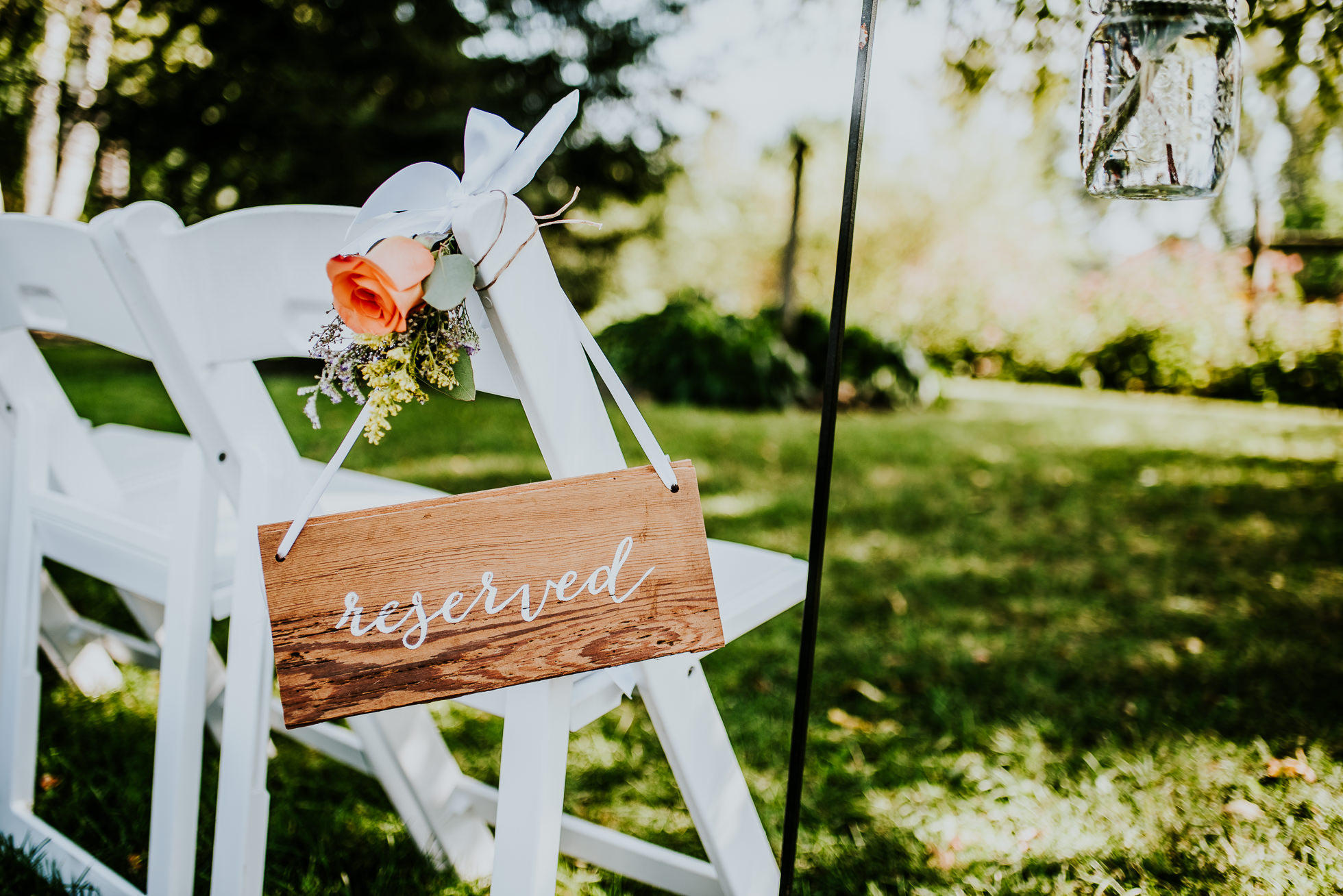 ceremony reserved seating sign at olde tater barn wedding in central bridge, ny photographed by traverse the tides