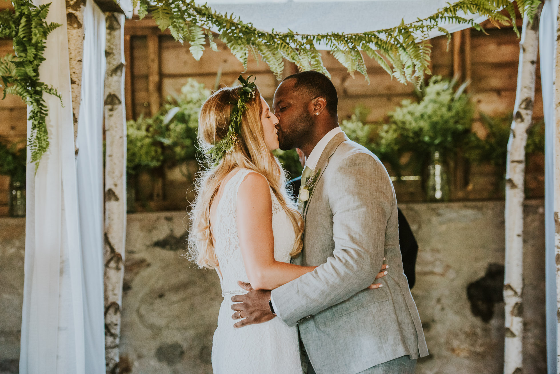 farm wedding first kiss photographed by Traverse the Tides