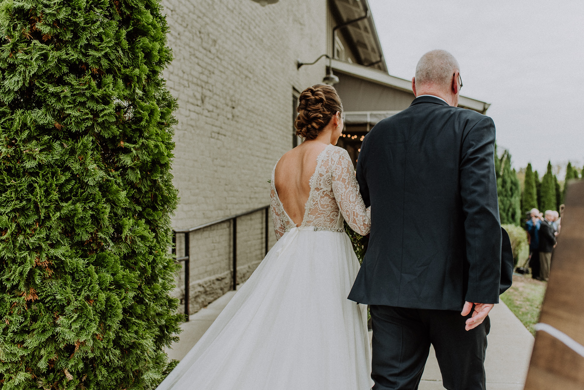 bride and father entering outdoor wedding ceremony at the cordelle nashville