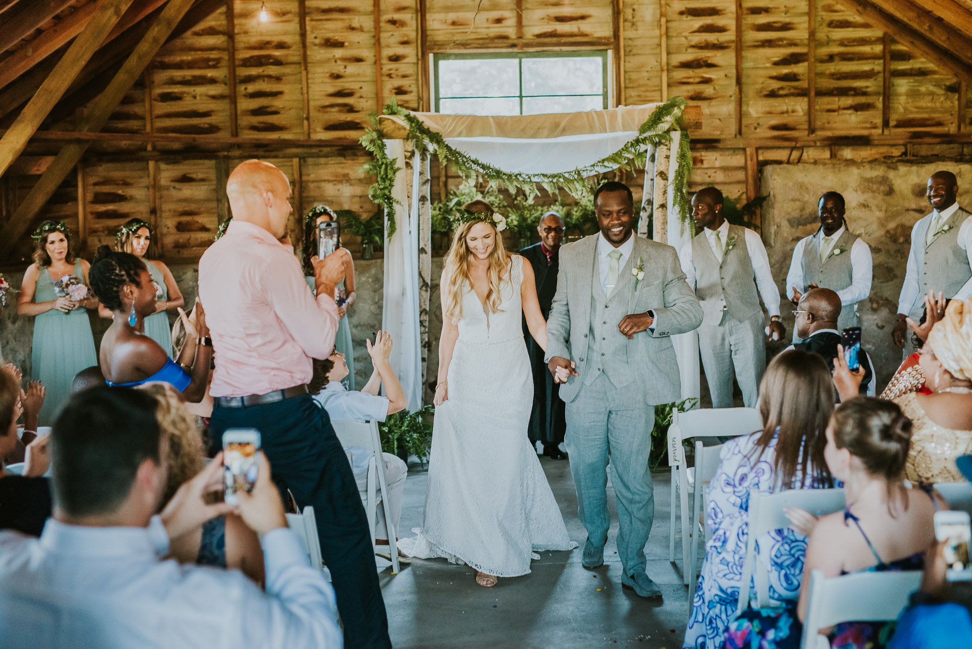 bride and groom exit rustic wedding photographed by Traverse the Tides