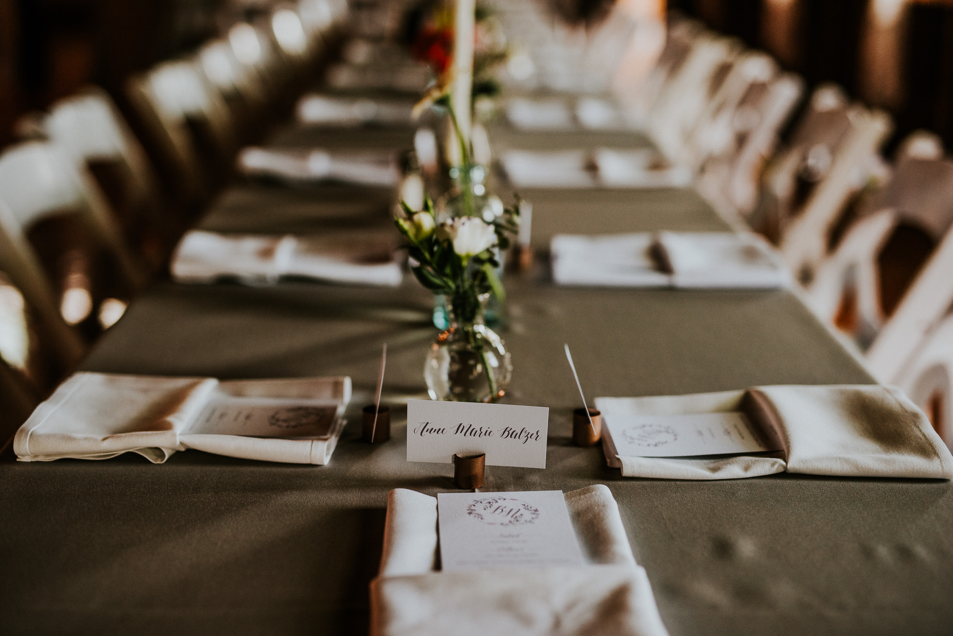 table seating at olde tater barn wedding photographed by traverse the tides