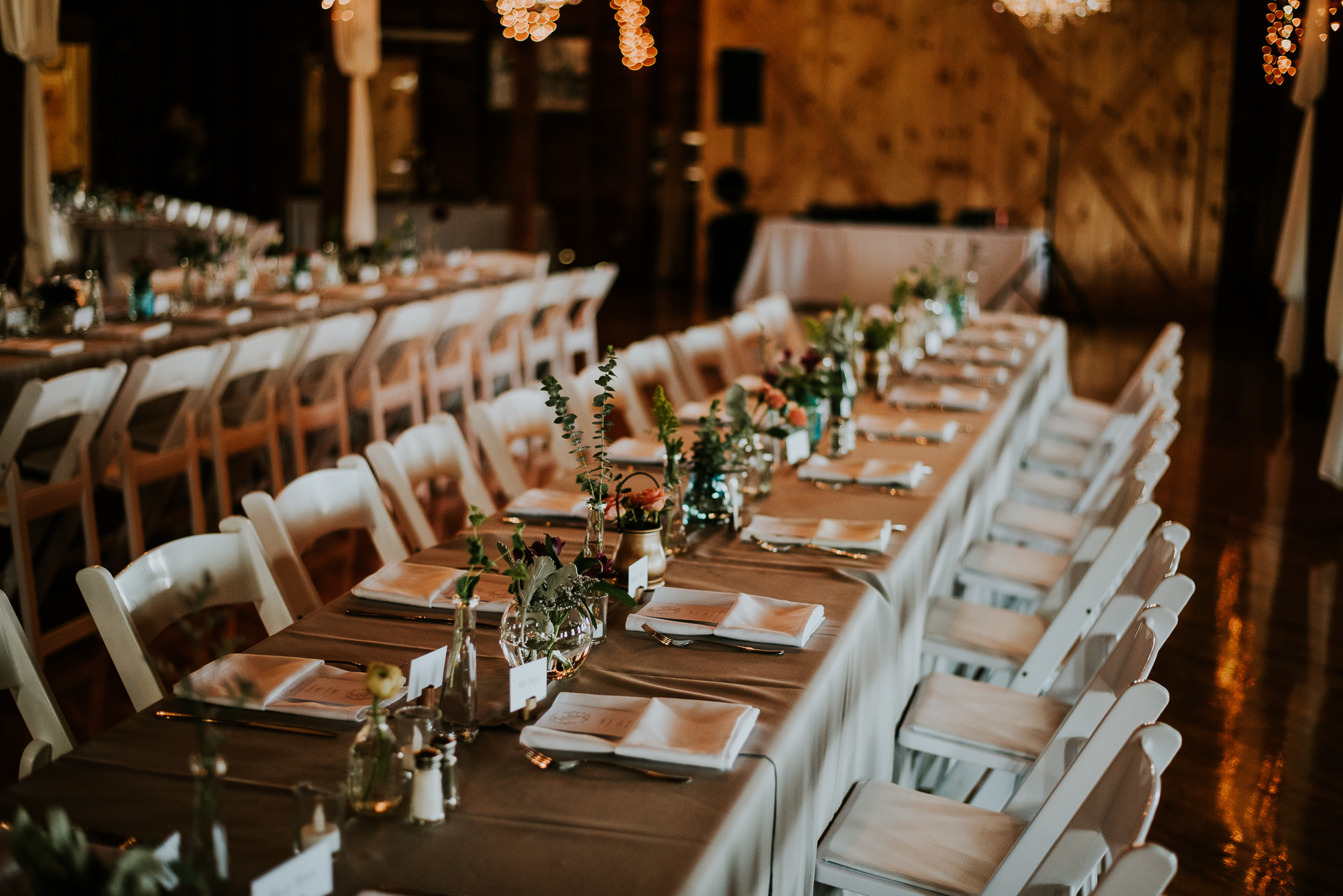 rustic seating at olde tater barn wedding photographed by traverse the tides