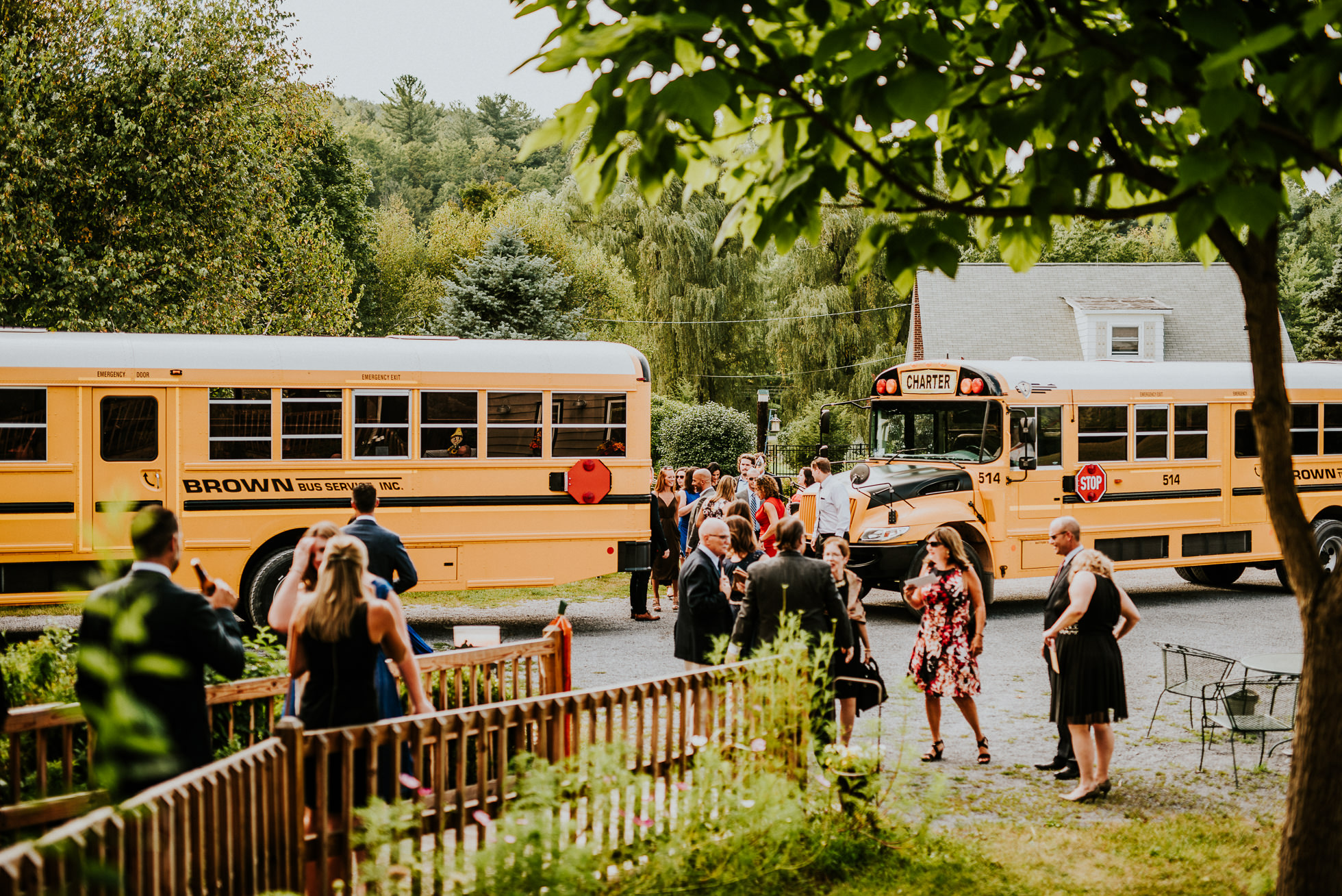 school bus bring guests at olde tater barn wedding photographed by traverse the tides