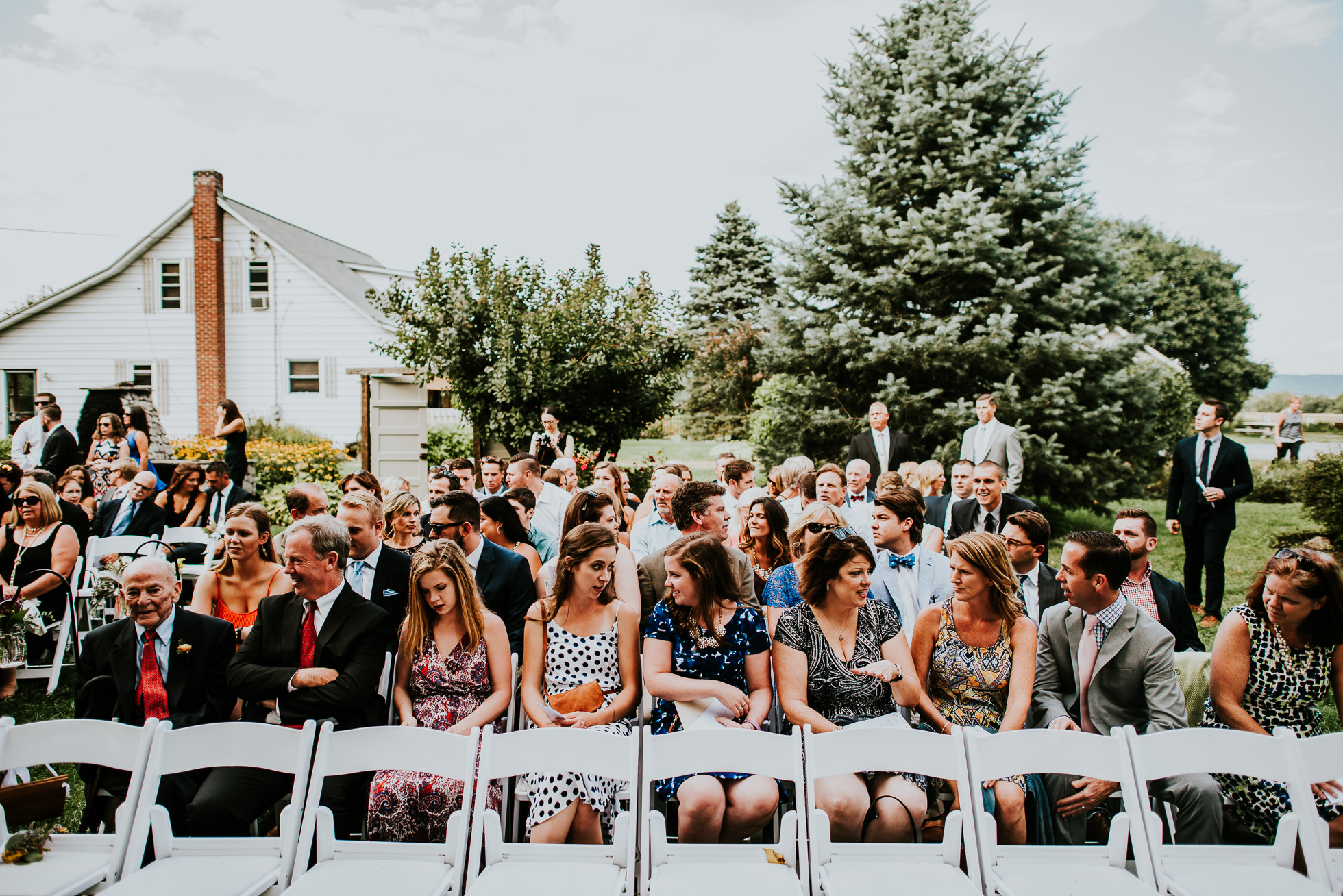 guests seated for ceremony at olde tater barn wedding in central bridge, ny photographed by traverse the tides