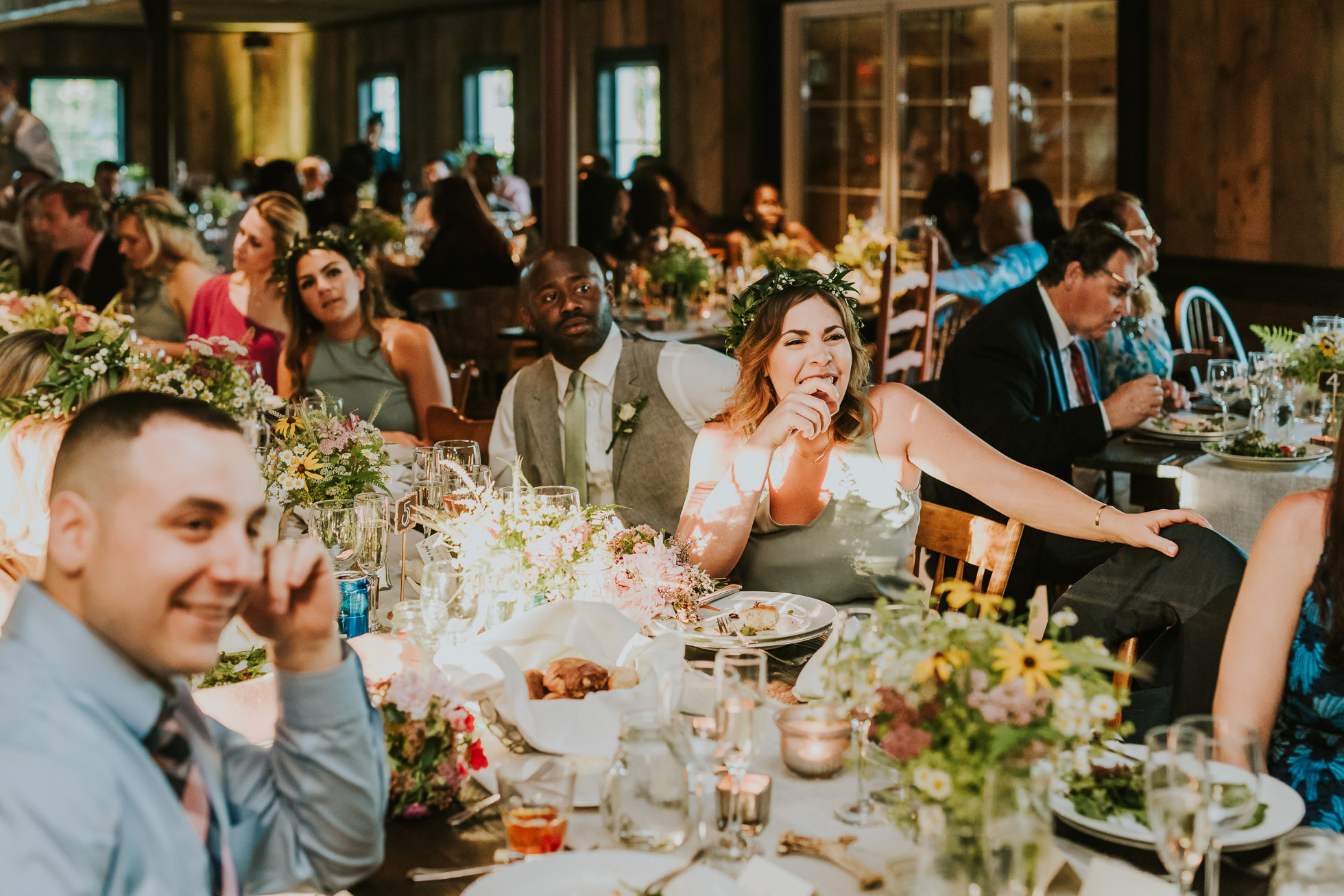 rustic wedding table with guests photographed by Traverse the Tides