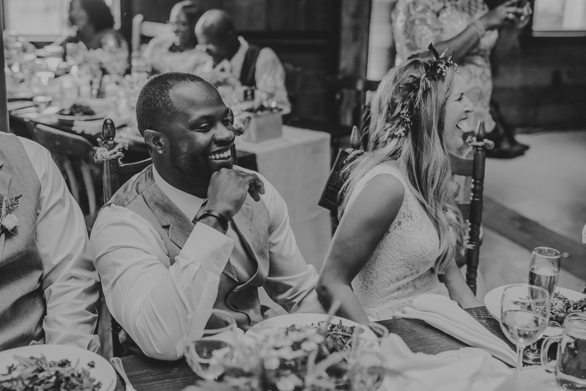 bride and groom in black and white photographed by Traverse the Tides