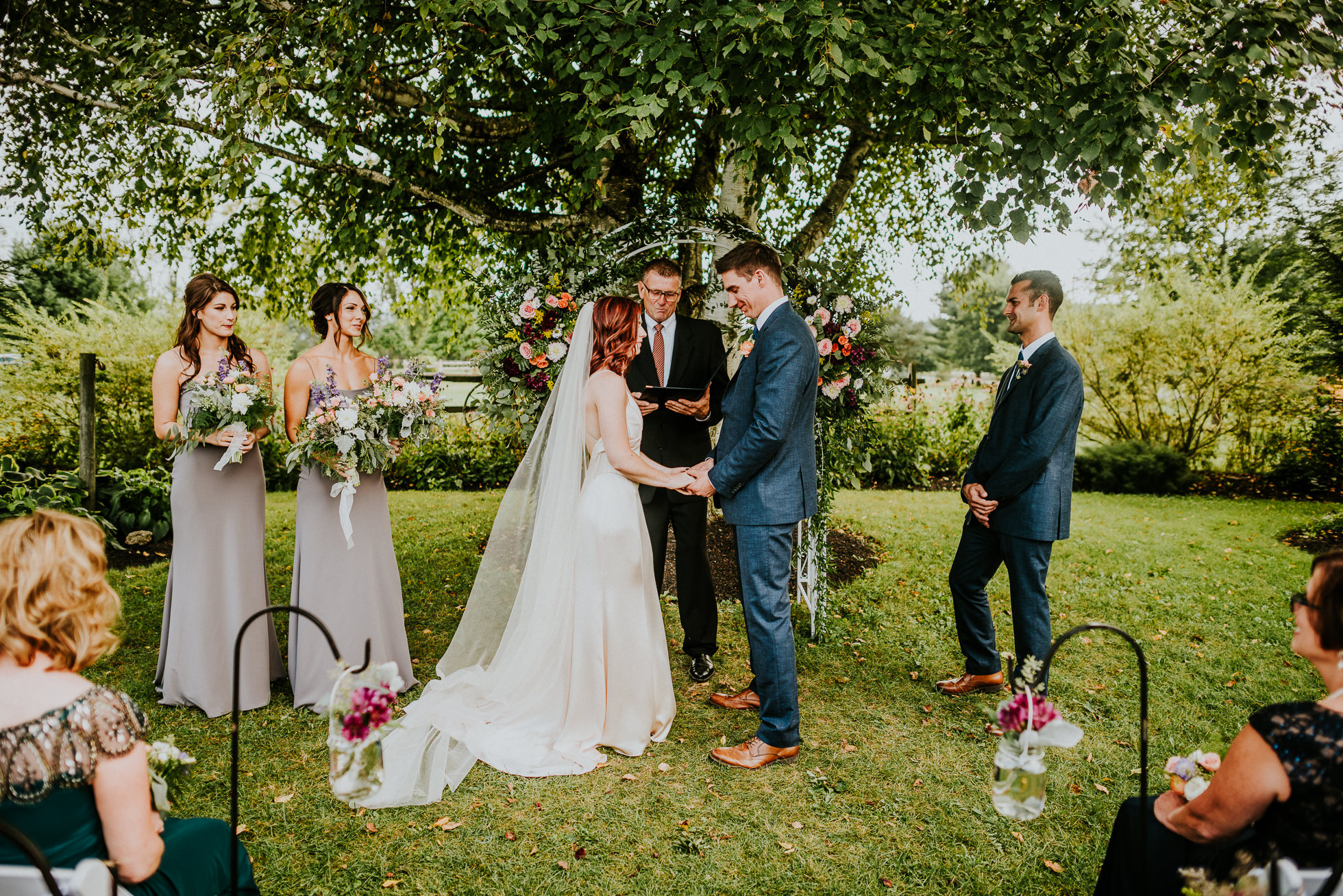 outdoor ceremony at olde tater barn wedding photographed by traverse the tides