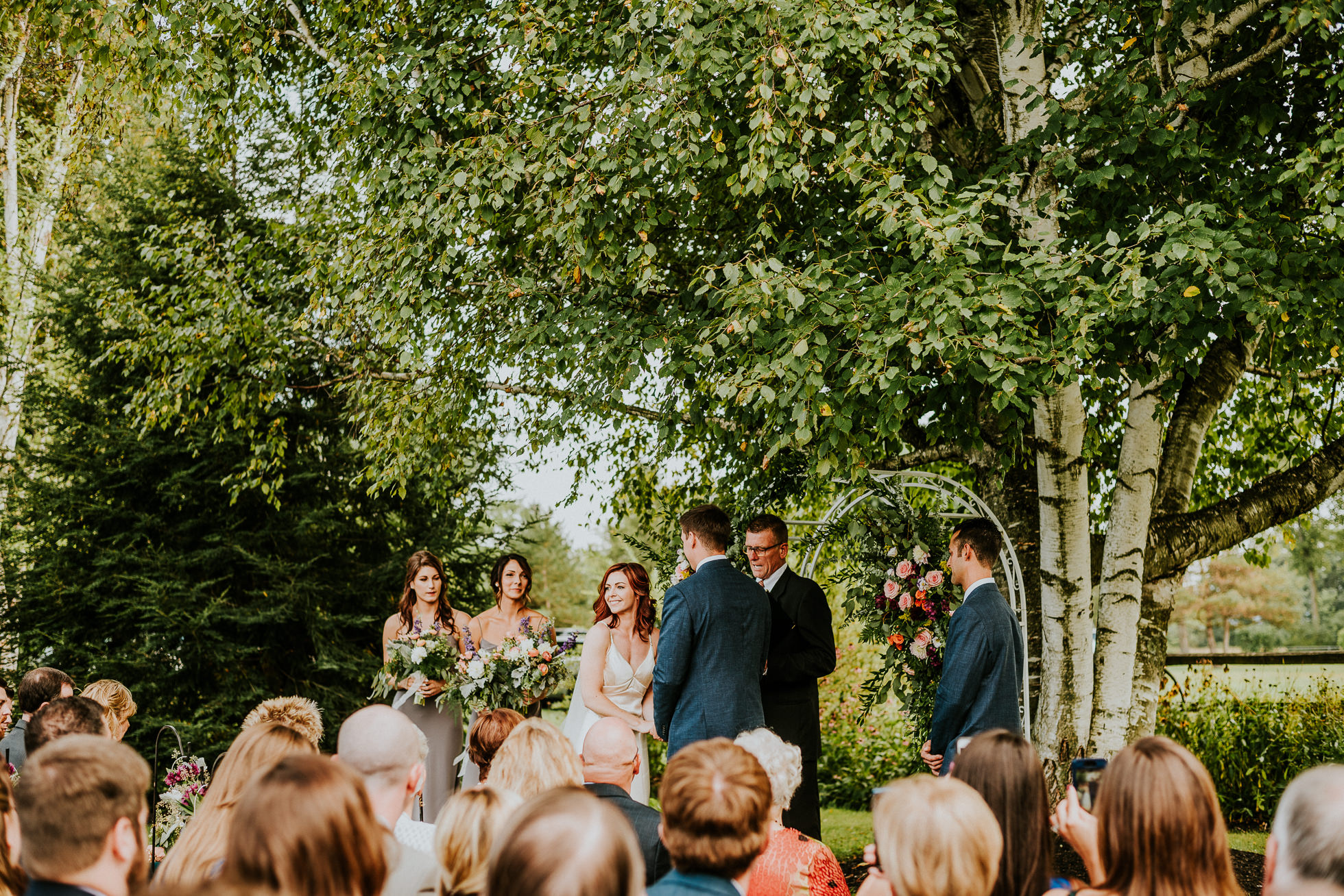 bride and groom outdoor ceremony at olde tater barn wedding in central bridge, ny photographed by traverse the tides