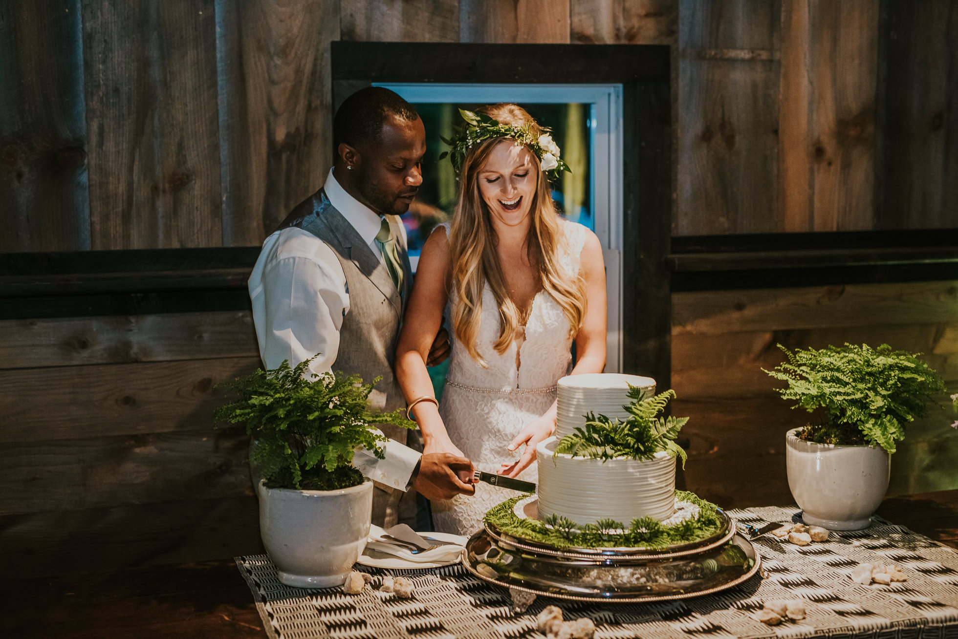 rustic wedding cake cutting photographed by Traverse the Tides