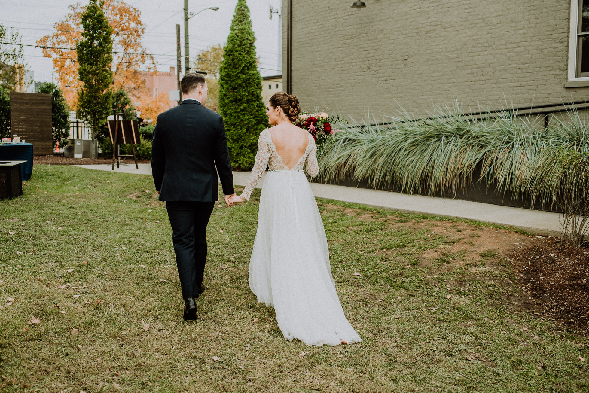 bride and groom exiting ceremony at the cordelle nashville wedding